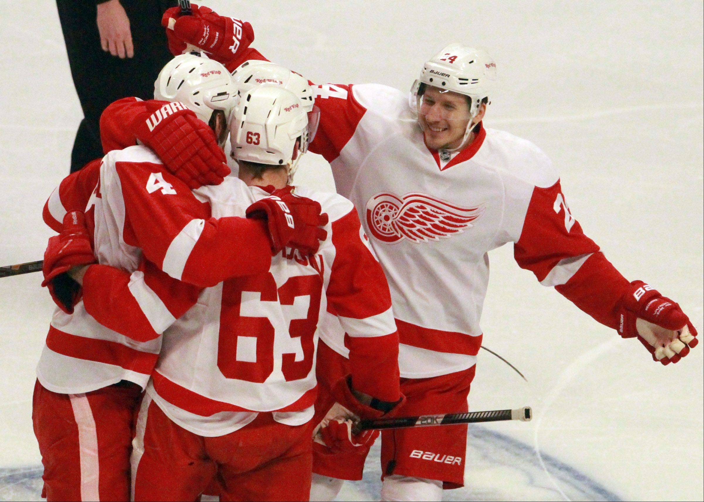 The Detroit Red Wings celebrate a goal by defenseman Brian Lashoff, right, during the second period of Game 2.