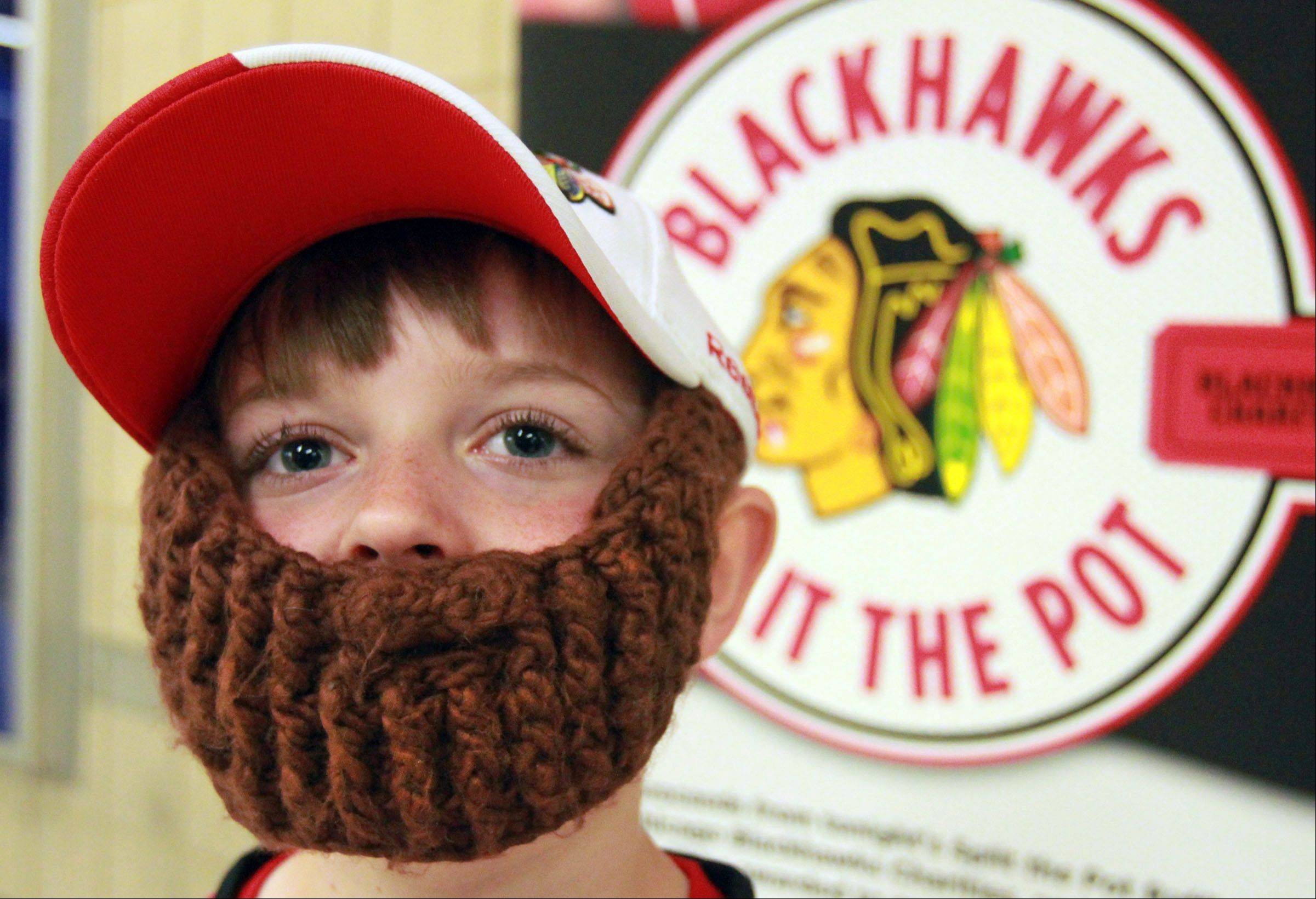 Connor Schaffer, 8, of Glenview, sports a makeshift beard at the Blackhawks second game against the Detroit Red Wings.