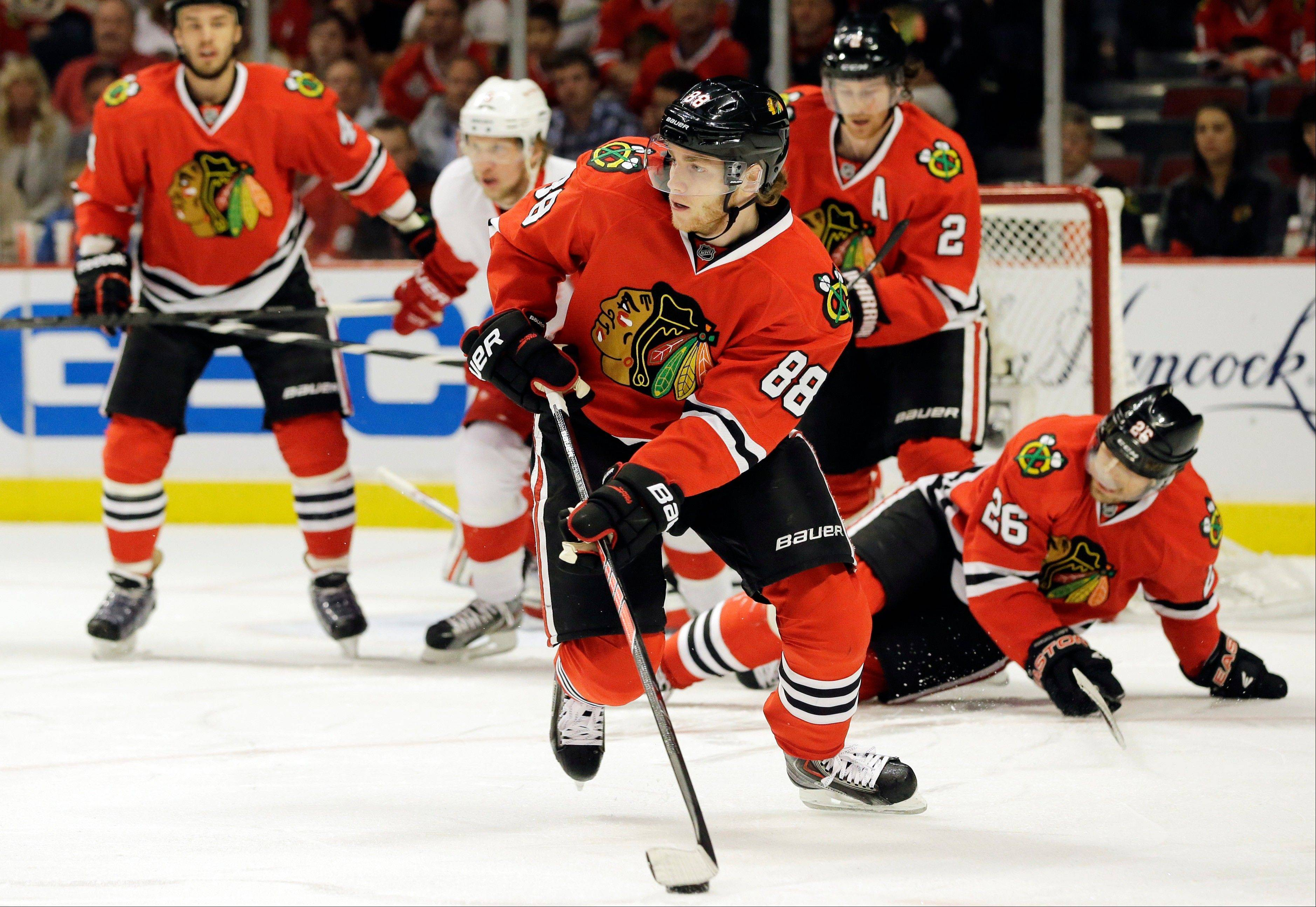 Patrick Kane looks to pass during the first period of Game 2.