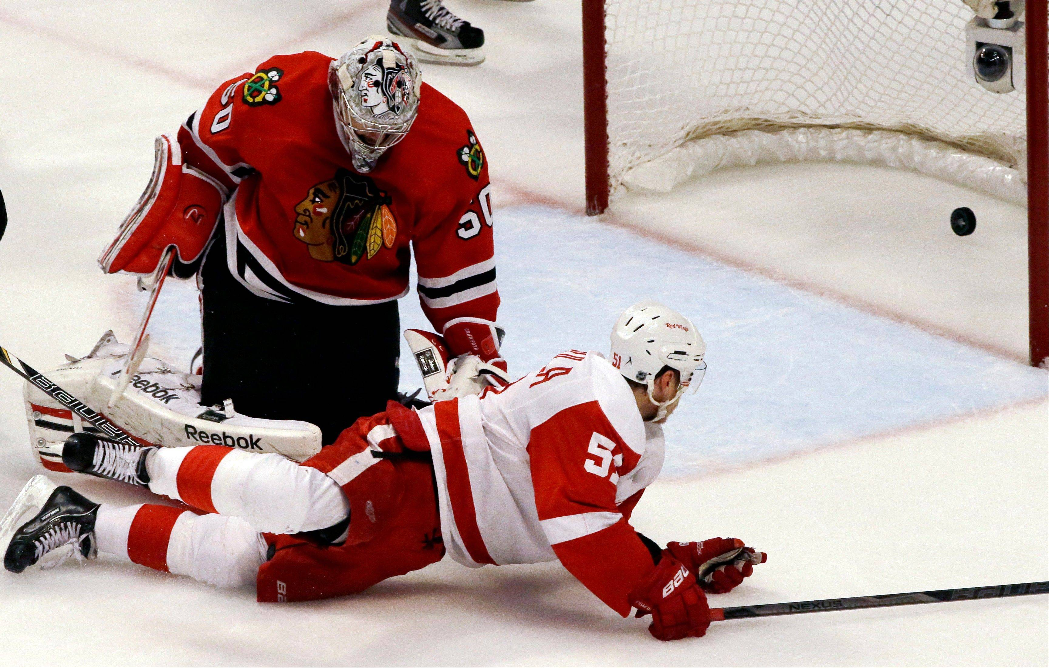 Detroit Red Wings' Valtteri Filppula scores against goalie Corey Crawford during the third period of Game 2.