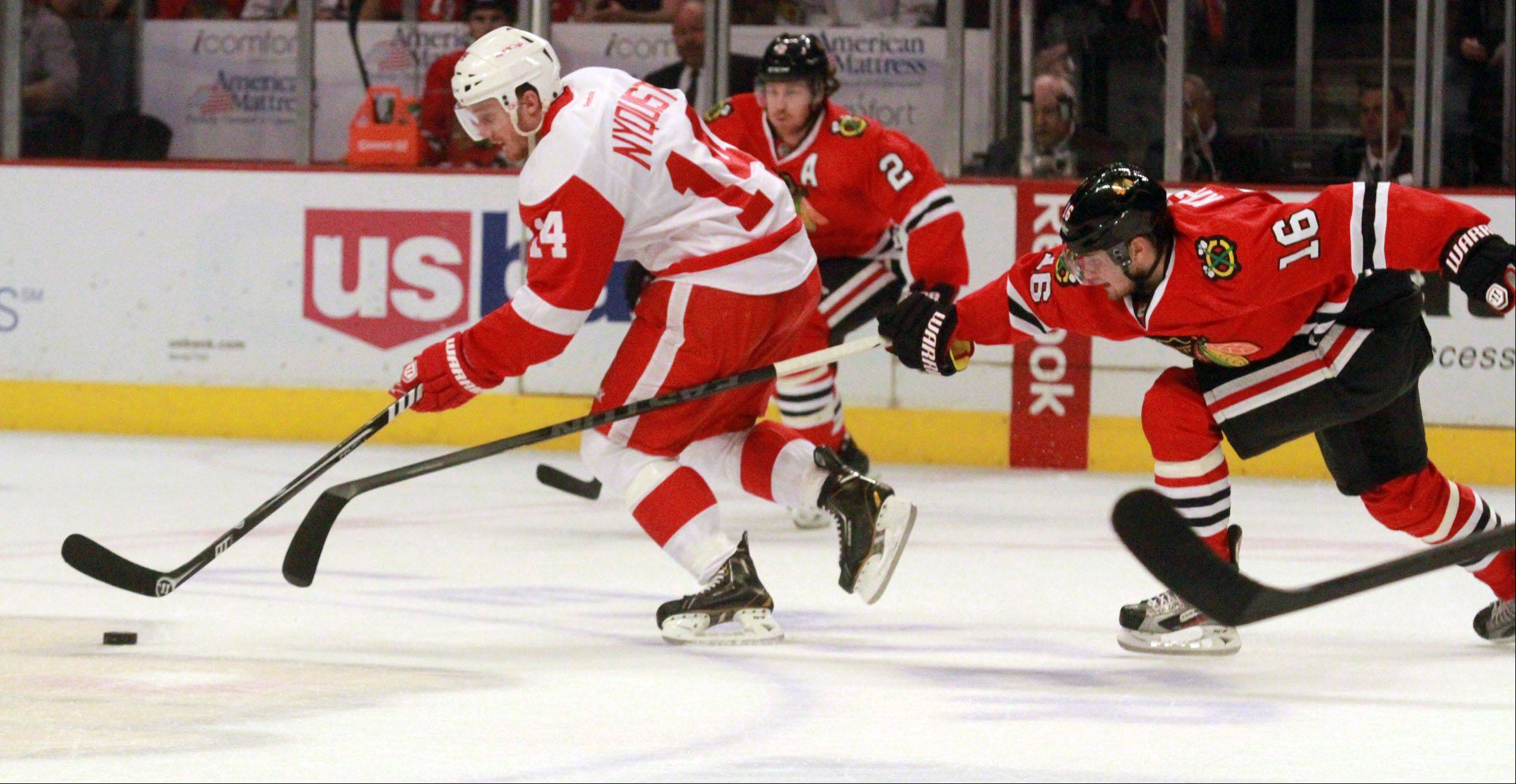 Center Marcus Kruger chases down Detroit Red Wings center Gustav Nyquist during the first period of game 2.