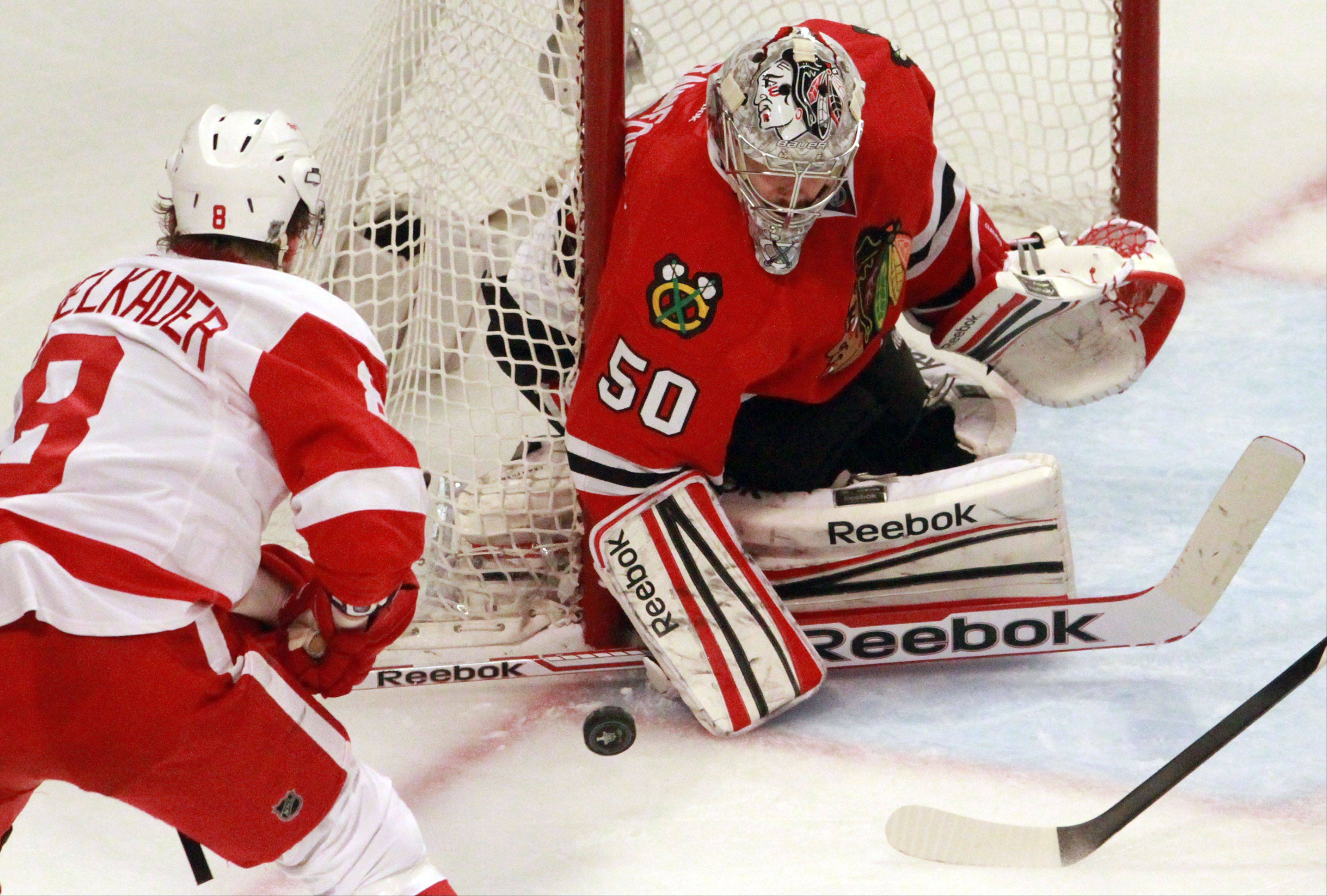 Corey Crawford stops a shot by Detroit Red Wings left wing Justin Abdelkader in the third period of Game 2.