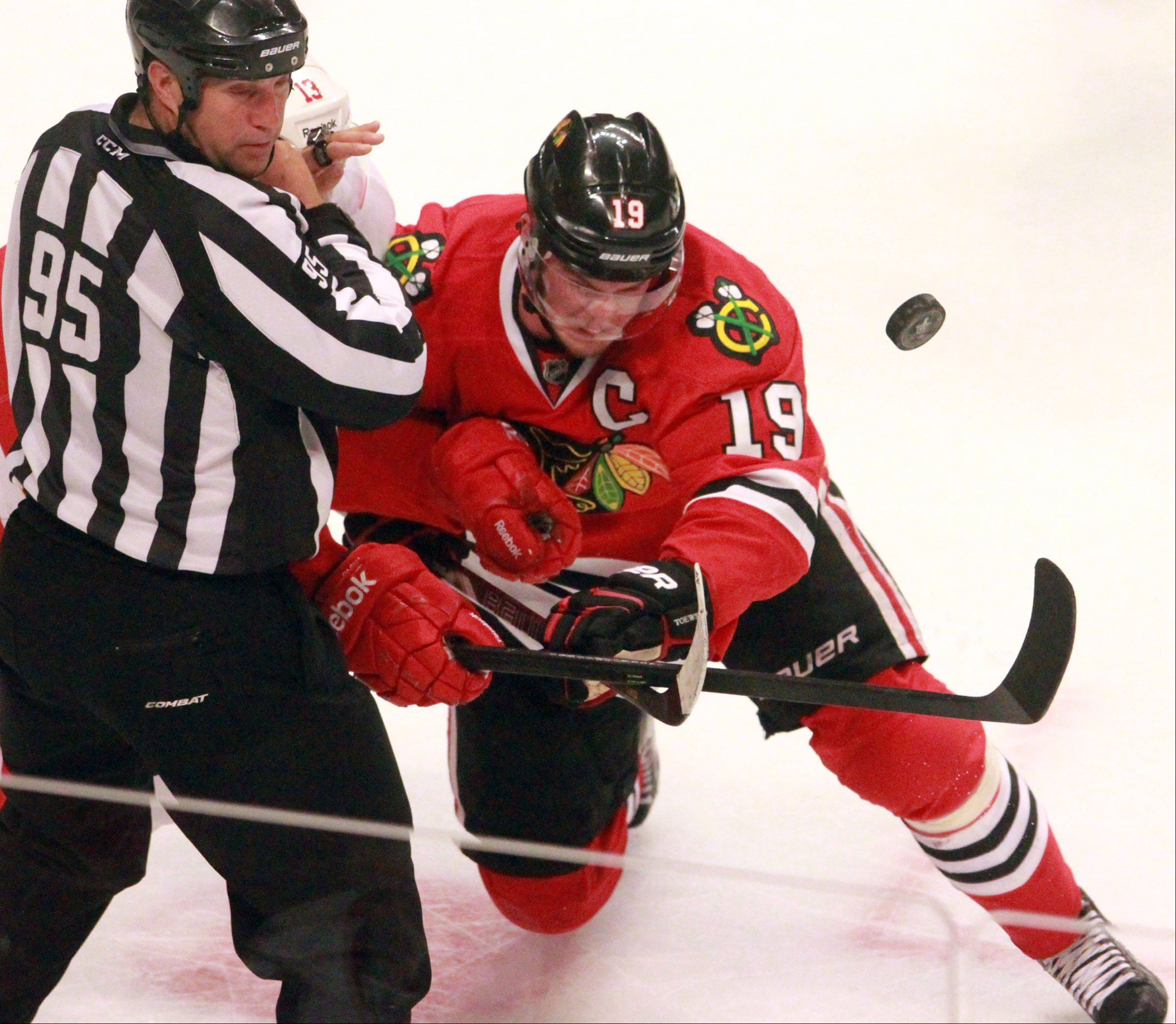 Jonathan Toews fights for puck position during the second period of Game 2.