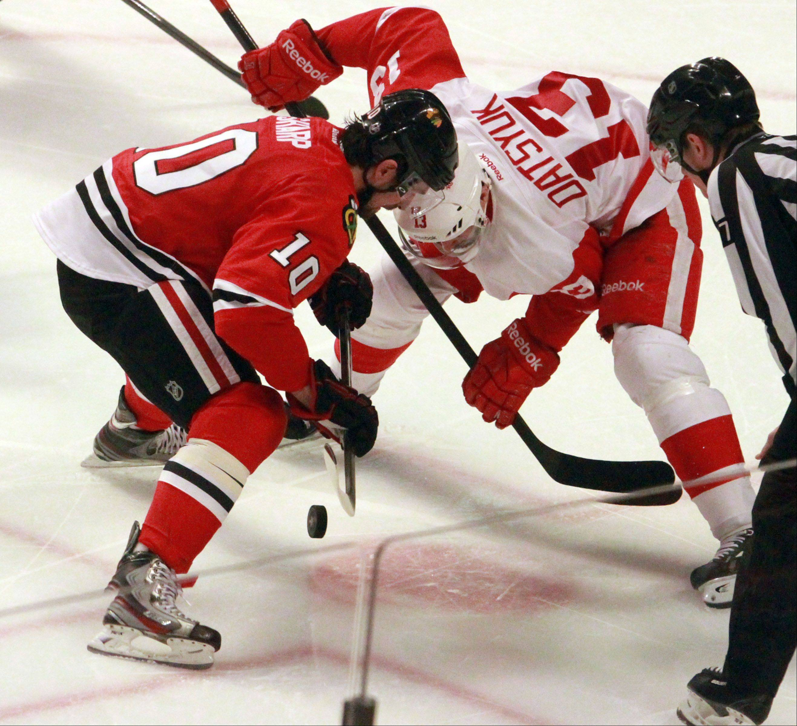 Center Patrick Sharp faces off with Detroit Red Wings center Pavel Datsyuk in third period.