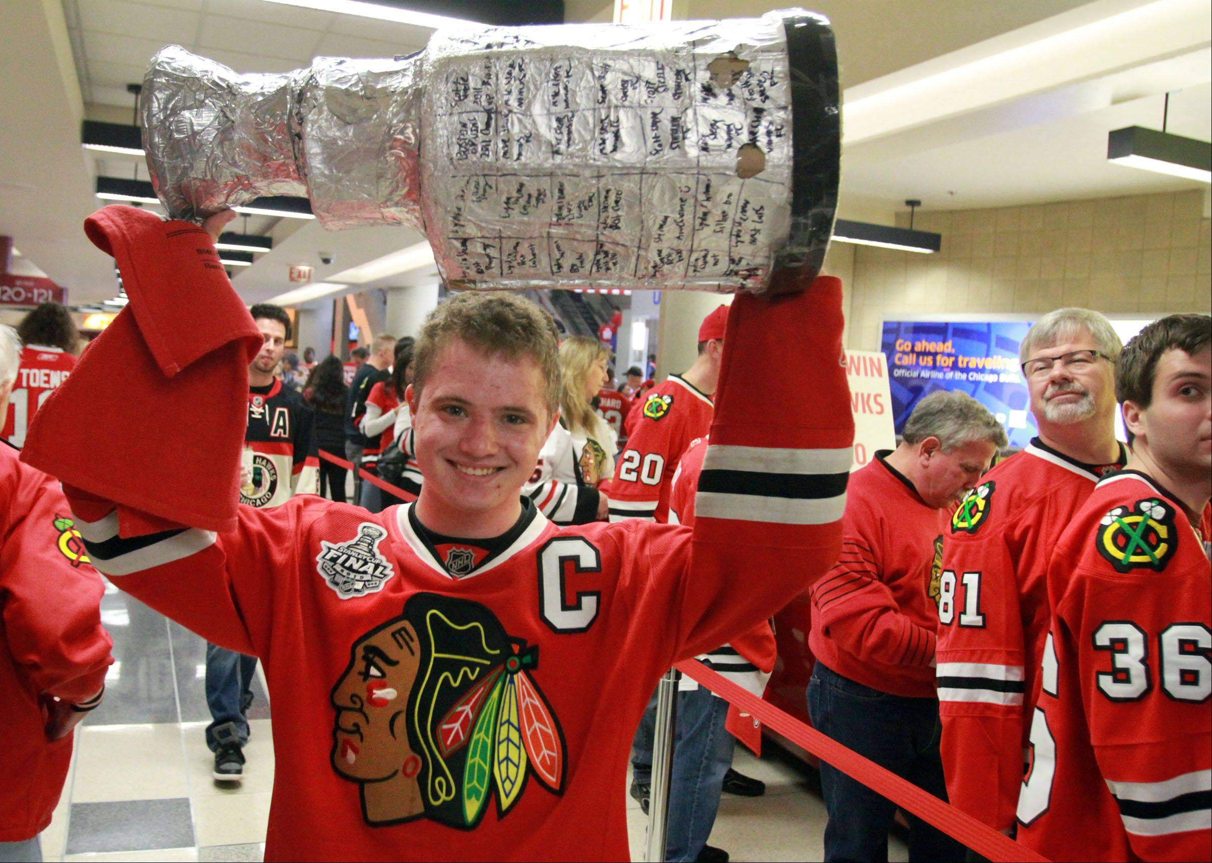 Michael Steele of Naperville brought a homemade replica of the Stanley Cup to the Blackhawks' second game against the Detroit Red Wings.