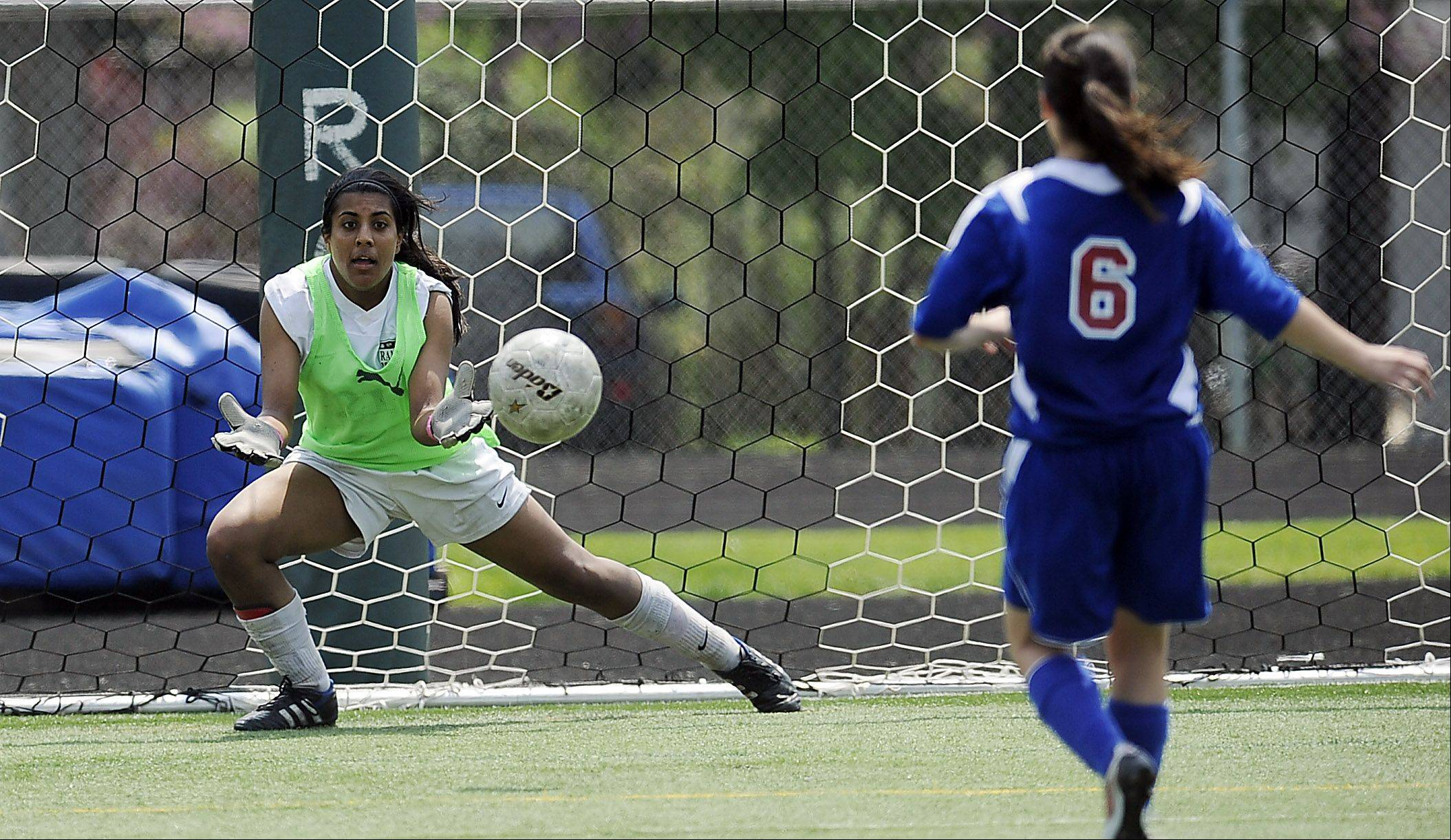 Grayslake Central goalie Kajal Chokshi prepares to block a shot by Lakes' Jessica Cipolla in a shootout victory in the Class 2A regional championship play Saturday.
