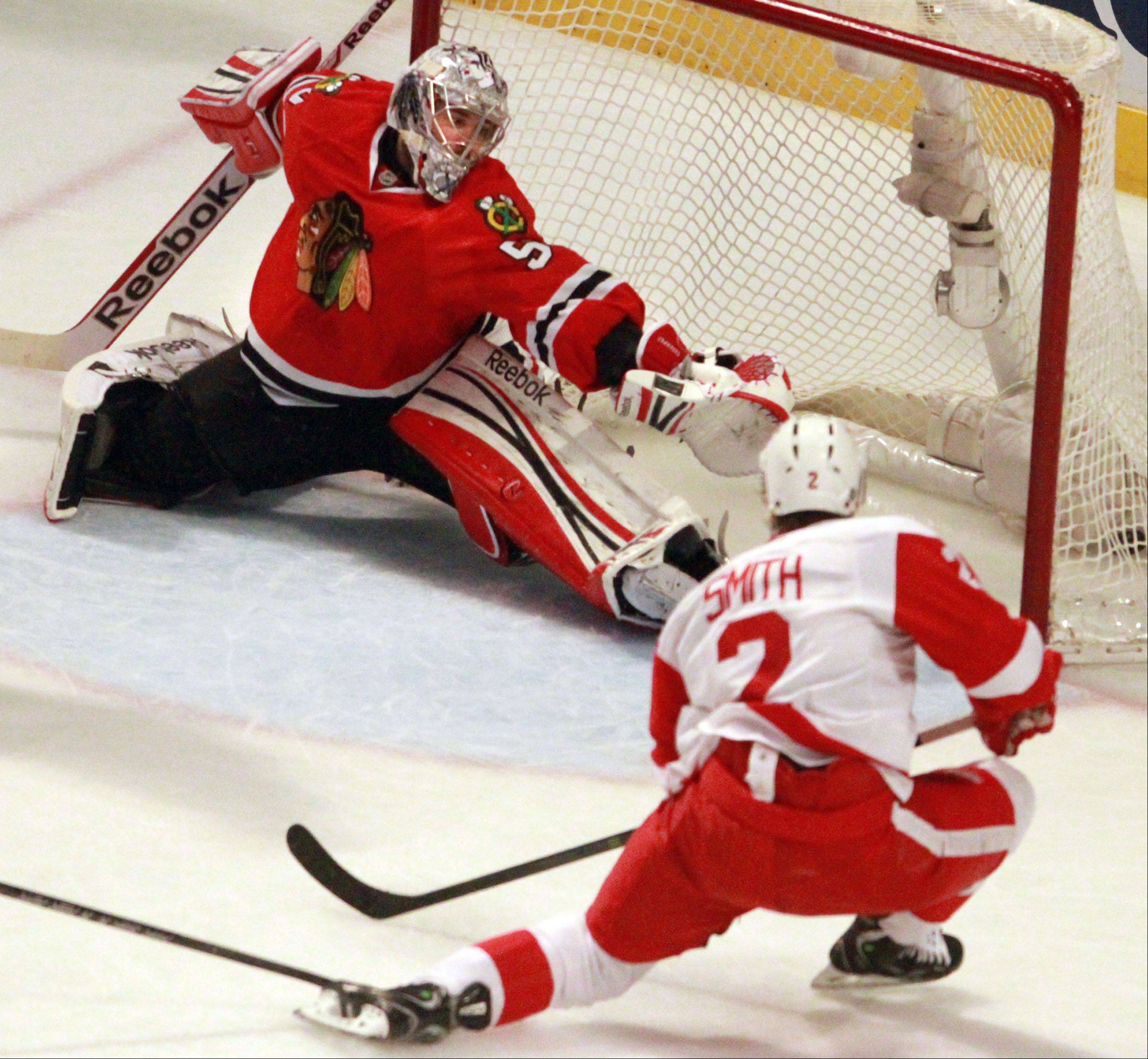 The Red Wings' Brendan Smith scores against Blackhawks goalie Corey Crawford during the second period Saturday.