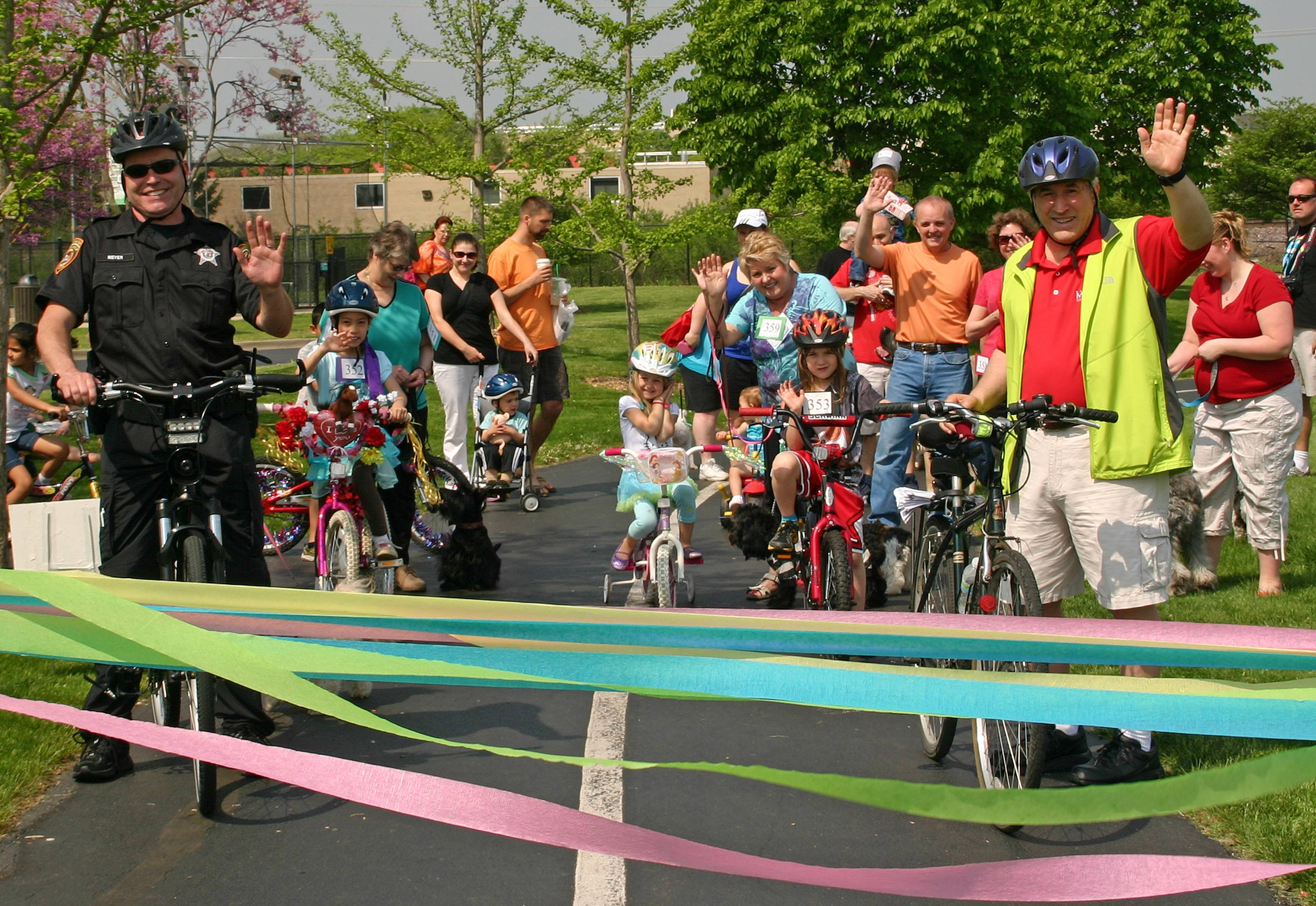 State Representative Martin J. Moylan and Des Plaines Officer Michael Meyers get ready to lead the 11th annual Pooch, Pet, and Pedal Parade through the park at Mountain View Adventure Center at the Spring Fun Fair on May 18.