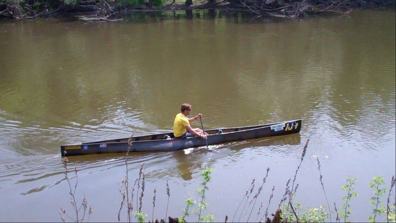 Joe Johnson of Menominee, Mich. was first to reach the shore at the Dam No. 2 Woods near Mount Prospect, which served as the finish line Sunday for the 56th Annual Des Plaines River Canoe and Kayak Marathon.