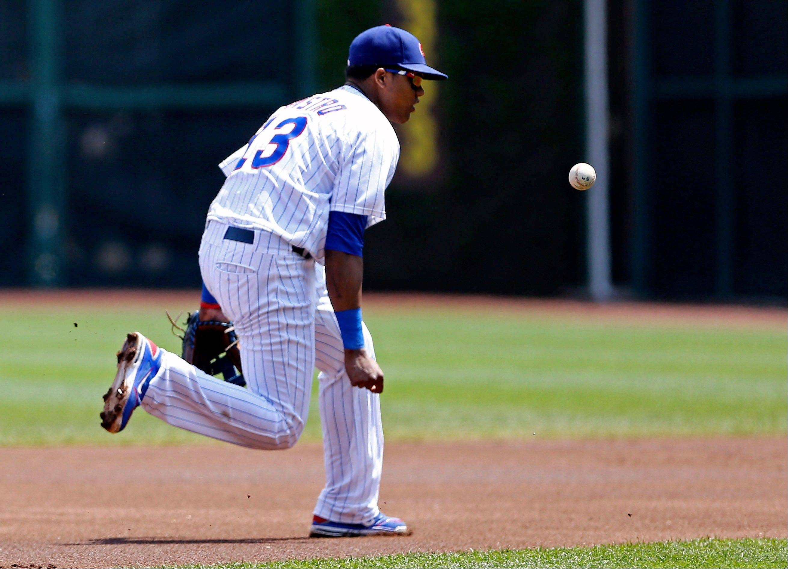 Cubs shortstop Starlin Castro can�t handle a hit by the Mets� Daniel Murphy during the first inning of Saturday�s game at Wrigley Field.