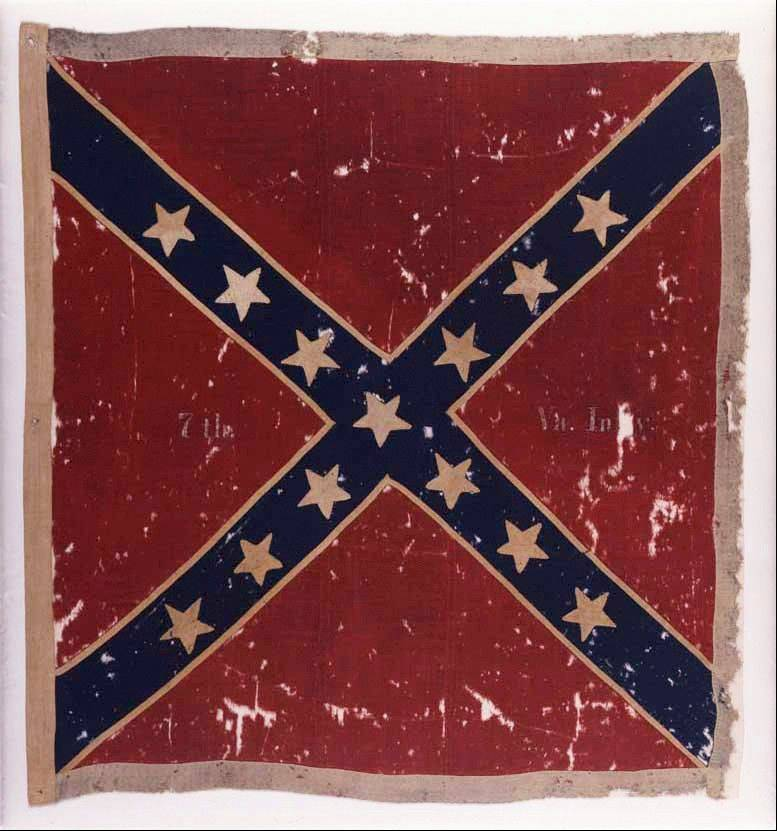 "The Confederate flag of the 7th Virginia Infantry Army of Northern Virginia Obverse captured at the Battle of Gettysburg, Pa., in July 1863 by the 82nd New York Infantry. The flag is part of an exhibit at the Museum of the Confederacy ""Gettysburg: They Walked through Blood."""