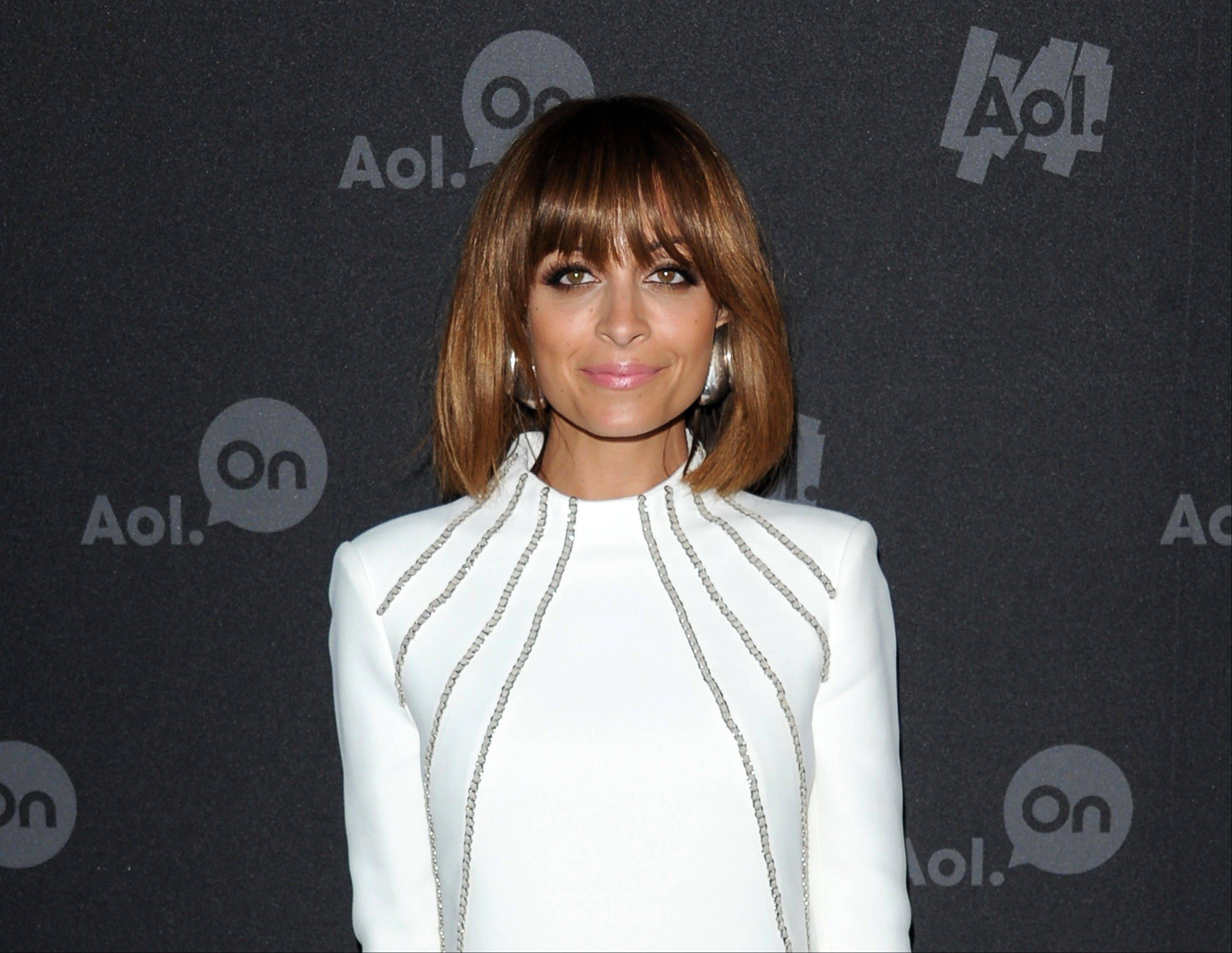 "Nicole Richie at AOL's web series NewFront to promote her series ""#CandidlyNicole"" in New York. The first webisode, where 31-year-old Richie consults with a doctor about having her ""tramp stamp"" (or tattoo on her lower back) removed, earned 1 million views in just its first week."