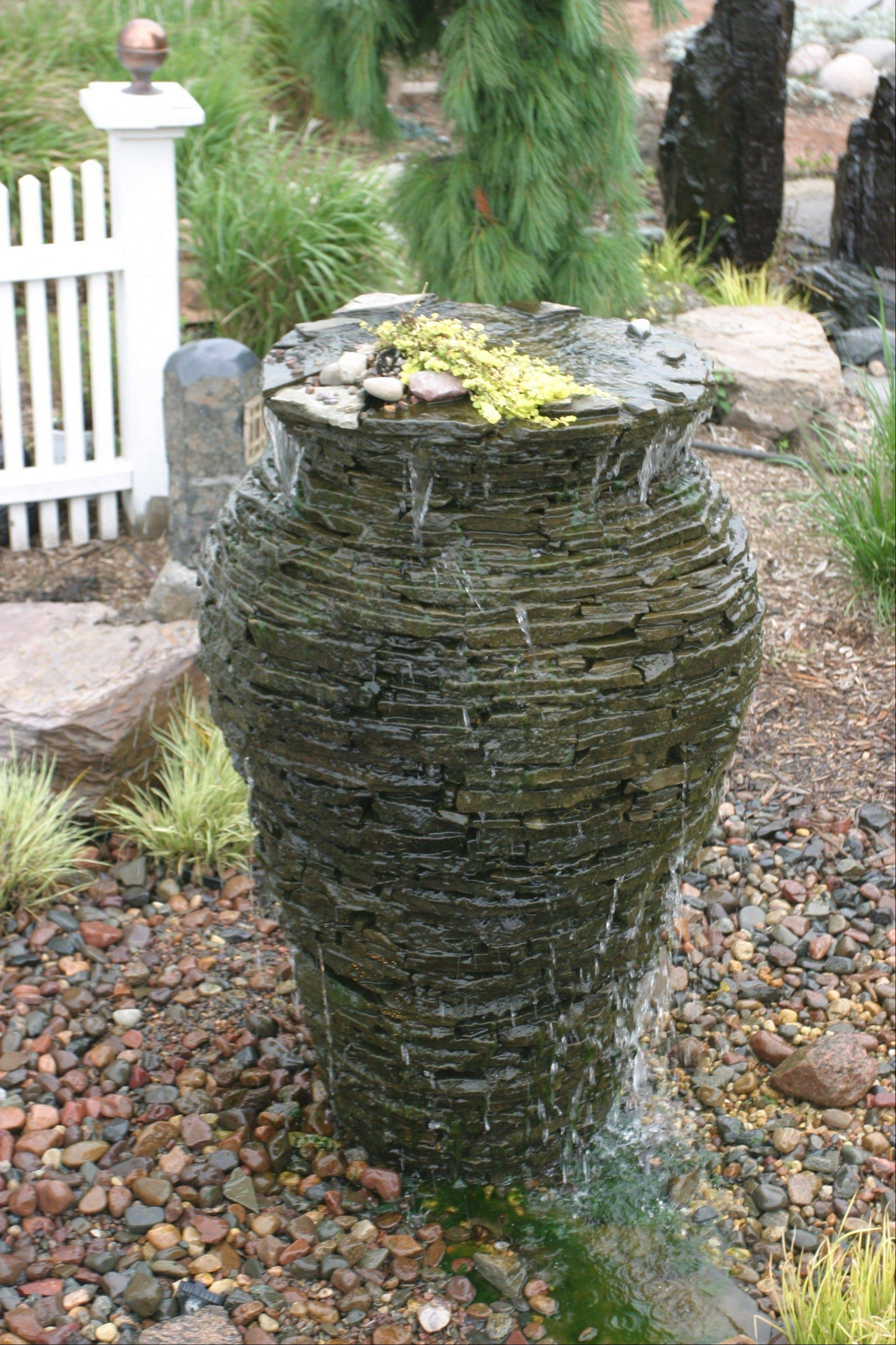 This stacked slate urn water feature is a different take on a waterfall.