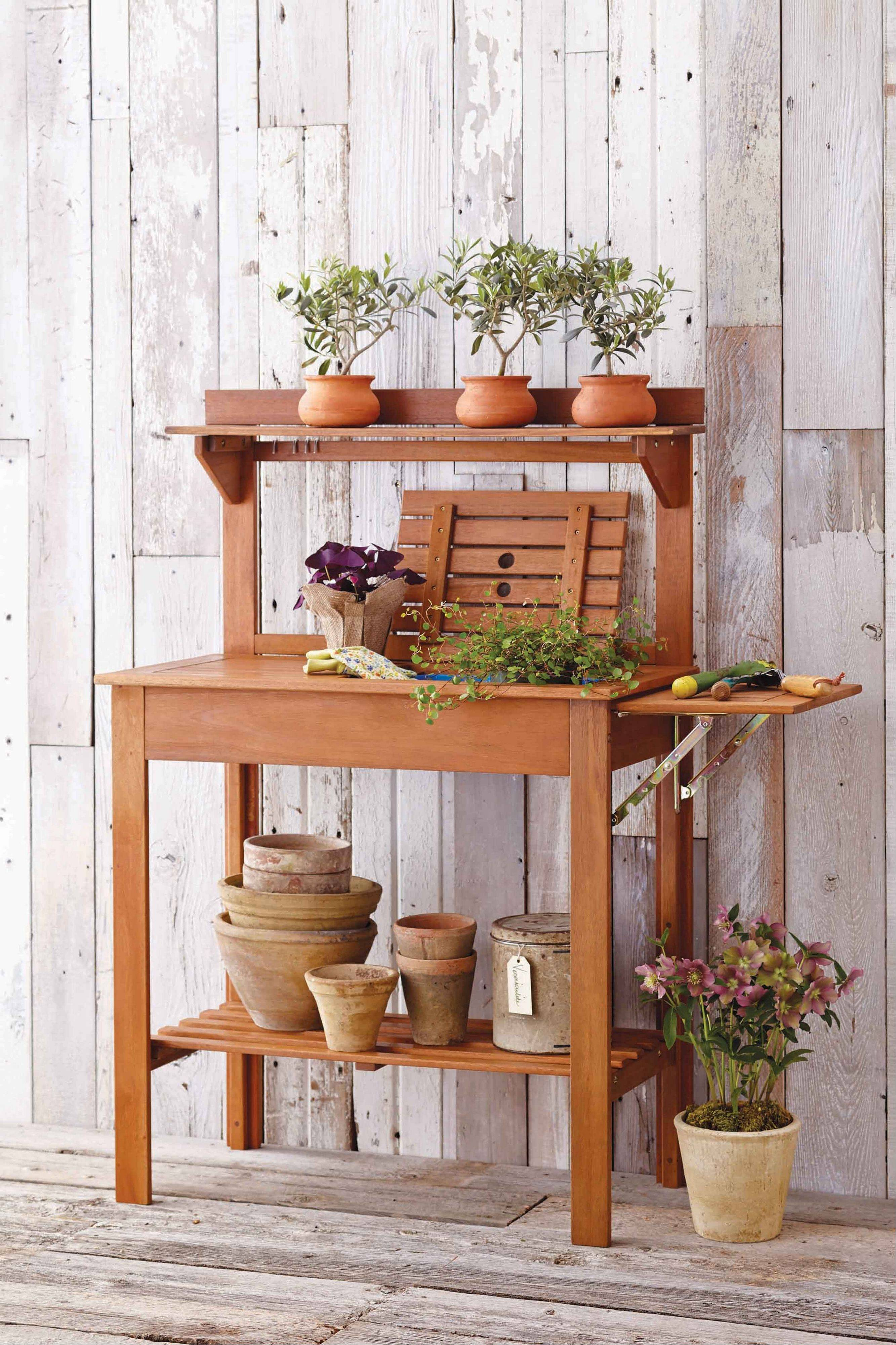 Small wooden potting benches help bring a garden to those with small outdoor space.
