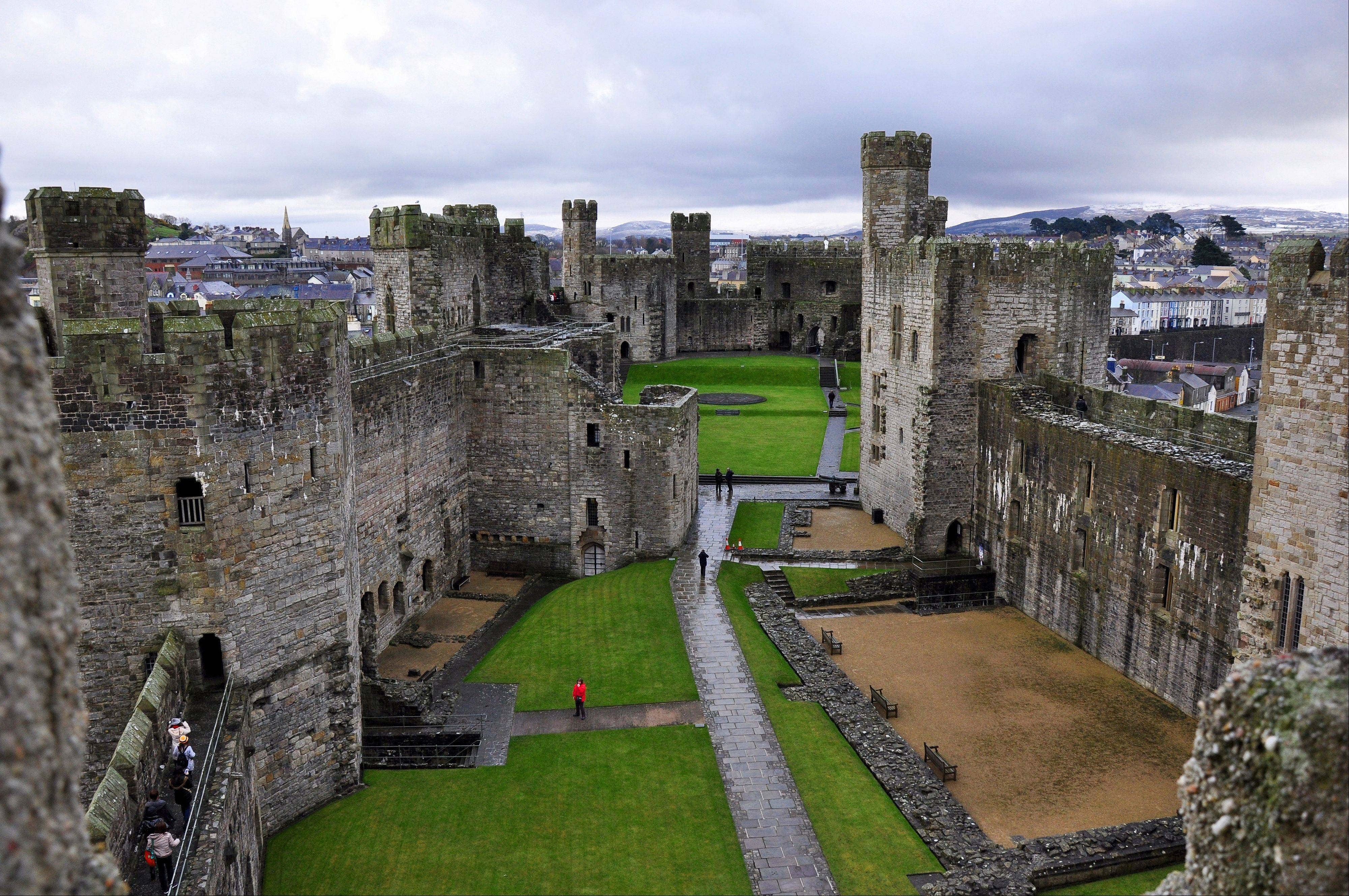 Queen Elizabeth invested Prince Charles as Prince of Wales at Caernarfon Castle in 1969, following a tradition dating back to the 13th century.