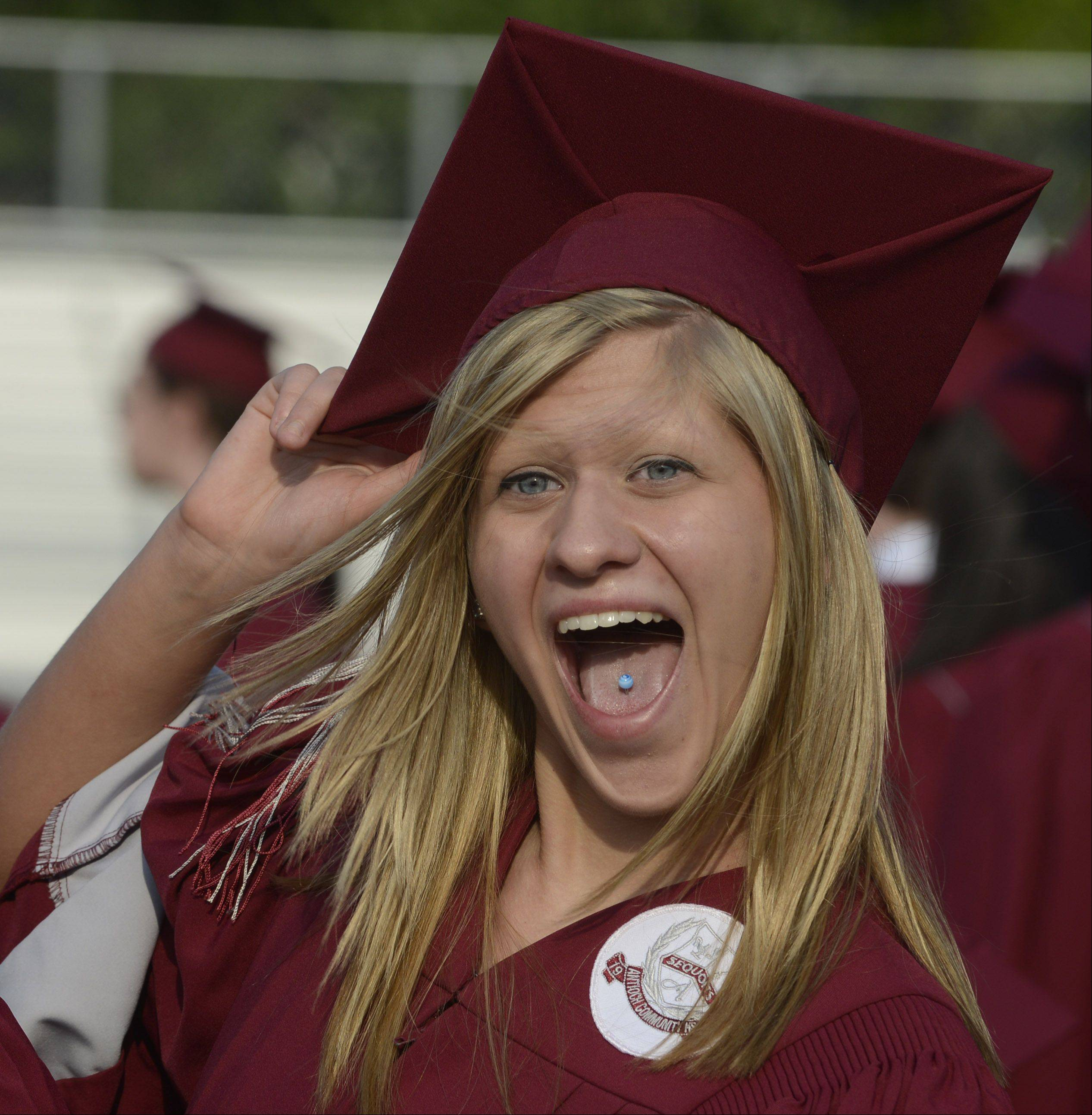 Danielle Rognstad greets a friend after receiving her diploma during the Antioch High School graduation Sunday.