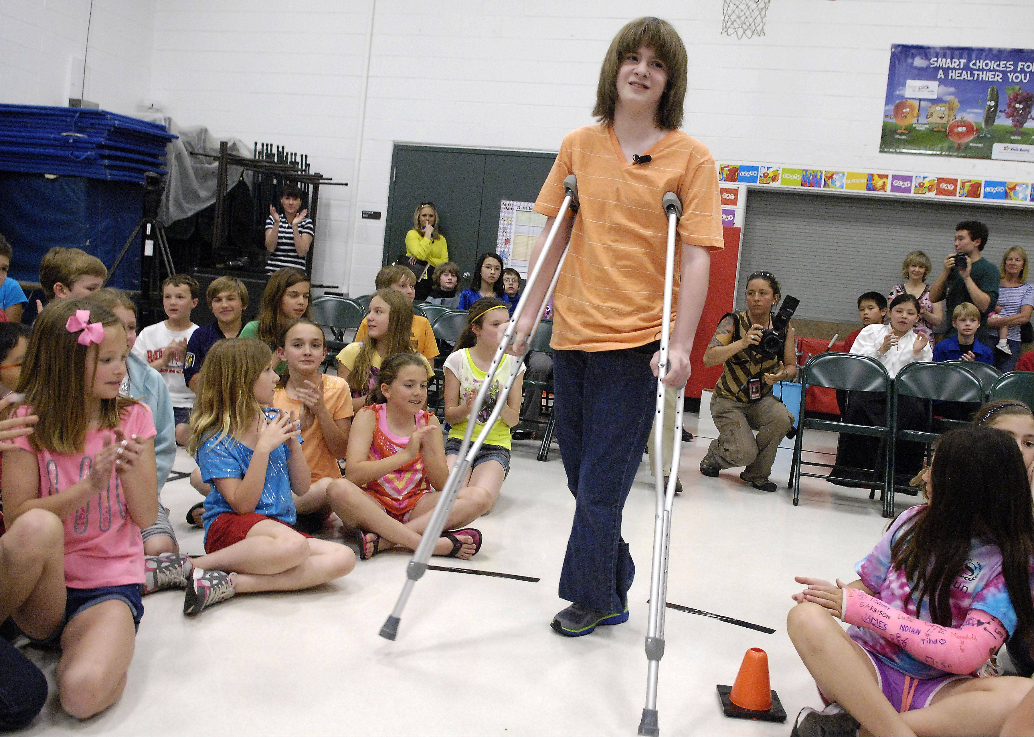 Dominic Szymanski, 11, comes back to Hough Street School in Barrington for the first time since losing his foot after being struck by a train in March. He is a fifth-grader at the school.