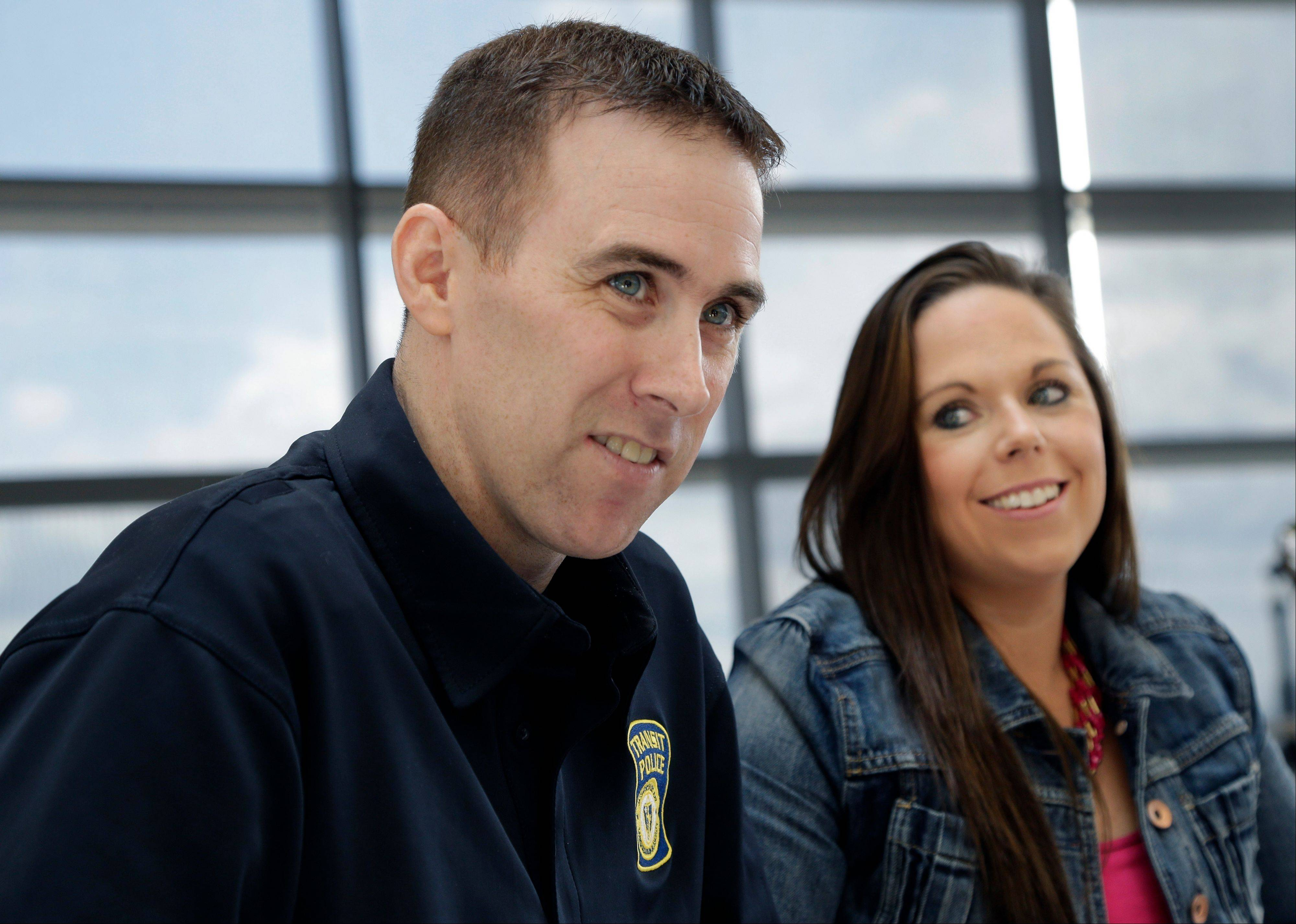 MBTA Police Officer Richard Donahue smiles with his wife, Kim, during an interview at Spaulding Rehabilitation Hospital in Boston's Charlestown section, Sunday, May 19, 2013. Donahue almost lost his life after being shot during the crossfire with the Boston Marathon bombing suspects in Watertown, Mass.