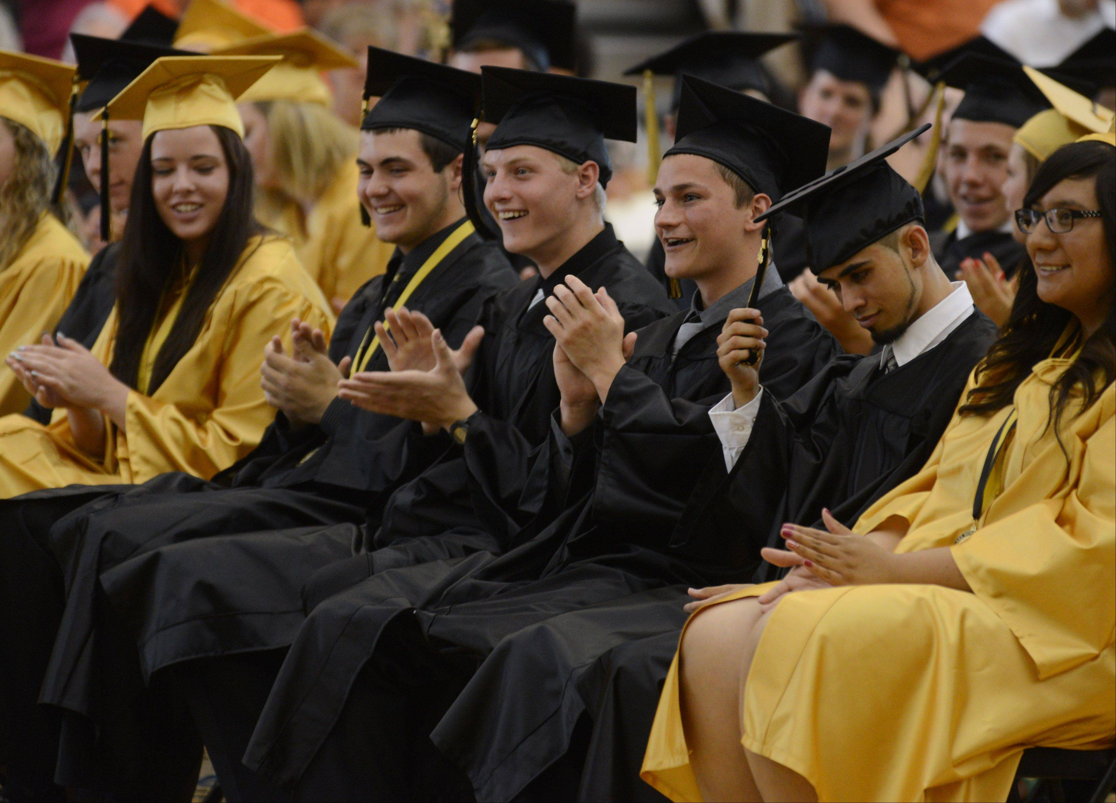 Grayslake North High School students enjoy the speeches during the graduation ceremony at the school Sunday.