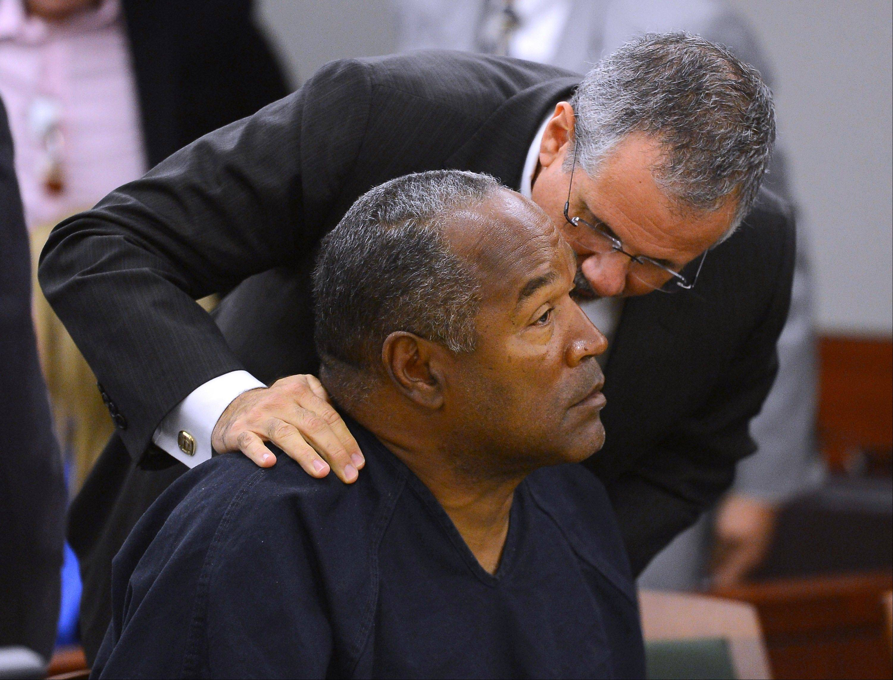O.J. Simpson and his defense attorney Ozzie Fumo confer in a Las Vegas court May 17. Simpson seeks a new trial, claiming he had such bad representation that his conviction should be reversed.