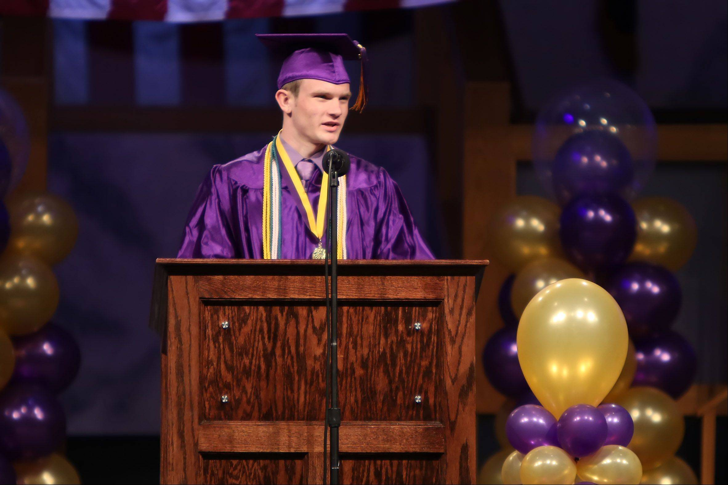 Senior honor student Colin Bernhardt gives his address during the Wauconda High School graduation at Quentin Road Bible Baptist Church on Sunday in Lake Zurich. There were 341 graduating seniors for the 97th annual commencement ceremony.