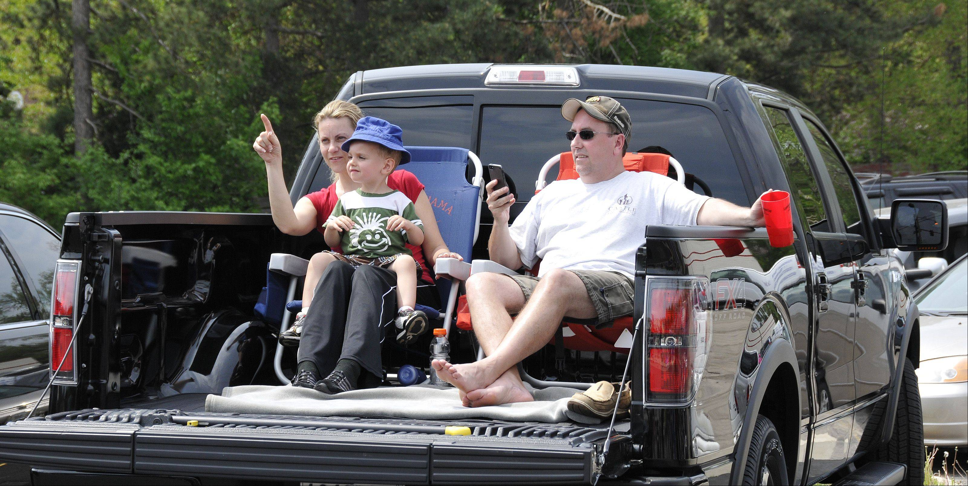 Dawn and Dane Paulsen, along with their son, Chase, put their pickup truck to good use on the parade route during Sunday's Lilac Parade in Lombard.