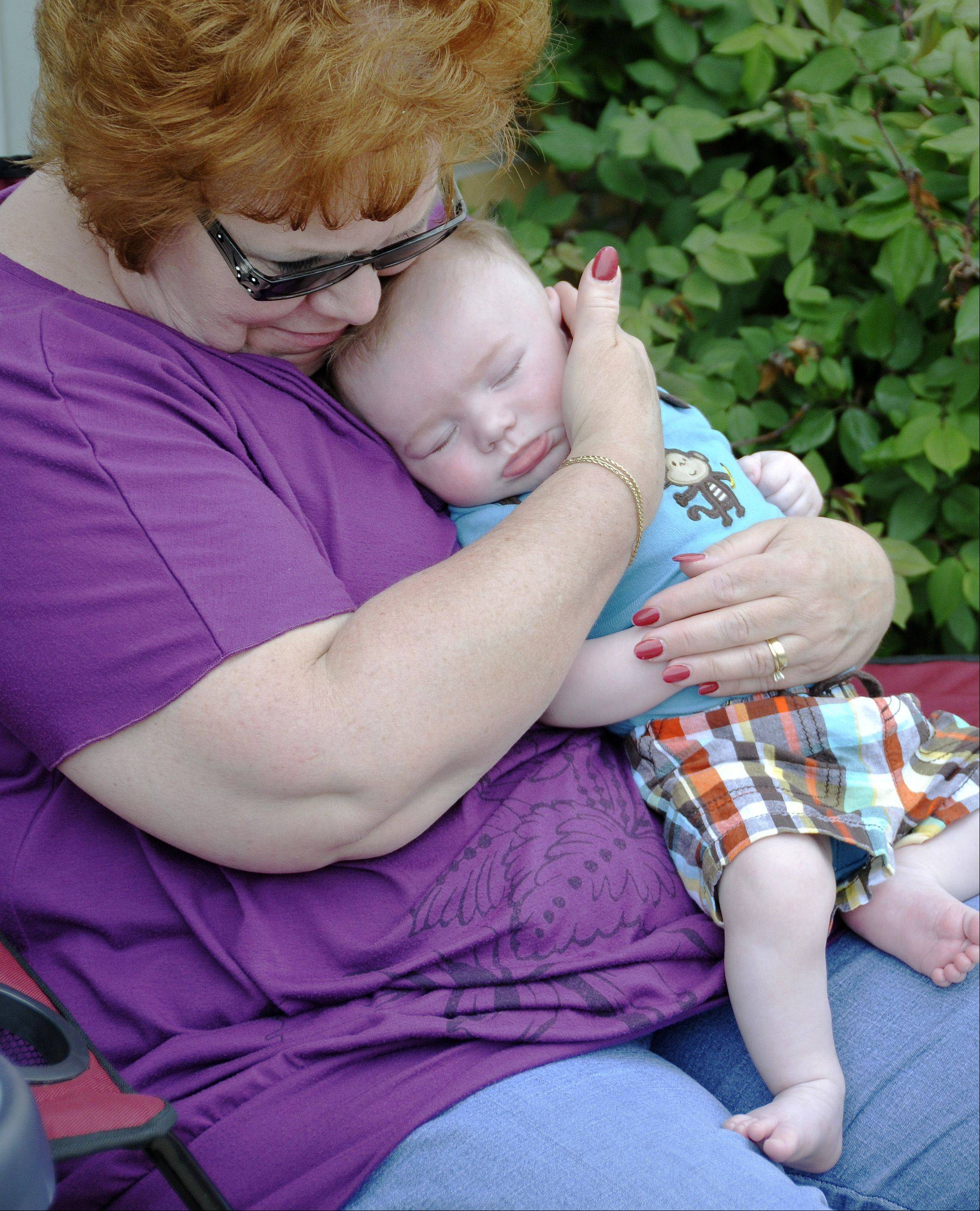The 59th annual Lilac Parade stepped off Sunday on Main Street in Lombard. Three-month-old Brady Carbon, of Lombard, had enough excitement after the fire trucks went by and fell asleep on his grandmother Denise Smelter's lap.