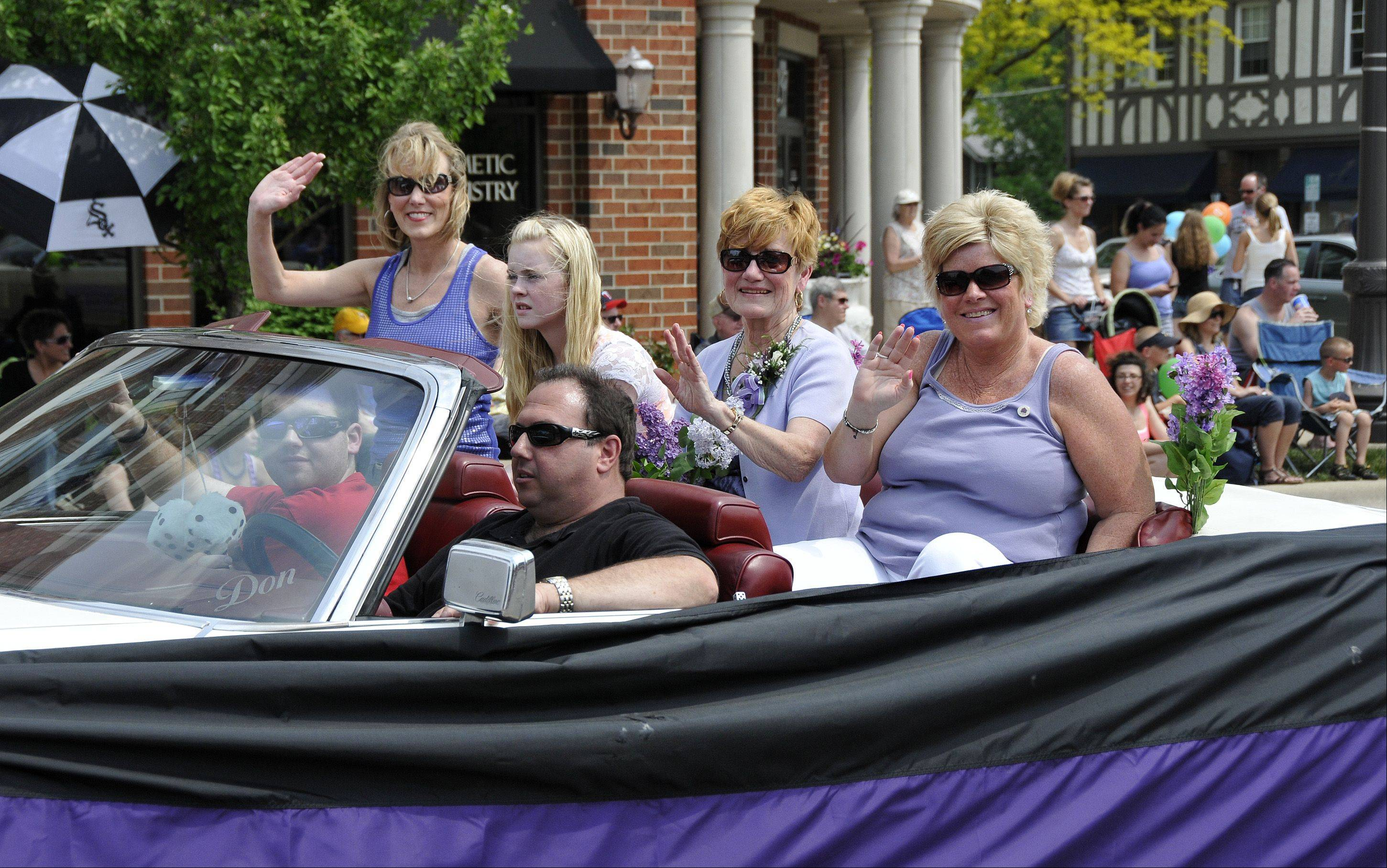 The 59th annual Lilac Parade stepped off Sunday on Main Street in Lombard. The family of Lombard's late mayor, Bill Mueller, were the grand marshals of the parade. Left to right in the back seat are Bill's daughter, Donna Fruehe, his granddaughter, Ashley Fruehe, his wife, Eileen Mueller, and his daughter, Debbie Rapata.