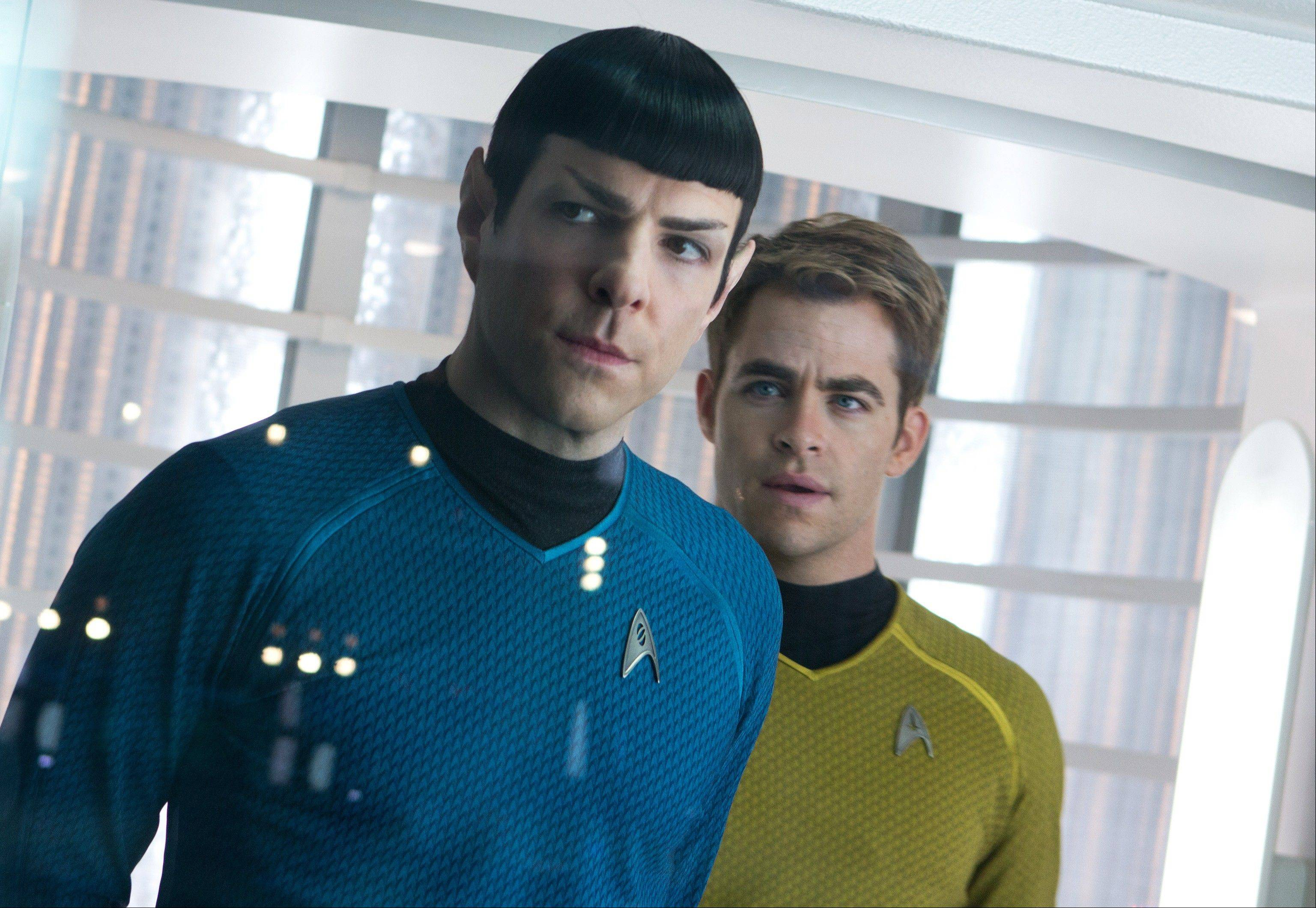 "This undated publicity film image released by Paramount Pictures shows, Zachary Quinto, left, as Spock and Chris Pine as Kirk in a scene in the movie, ""Star Trek Into Darkness,"" from Paramount Pictures and Skydance Productions."