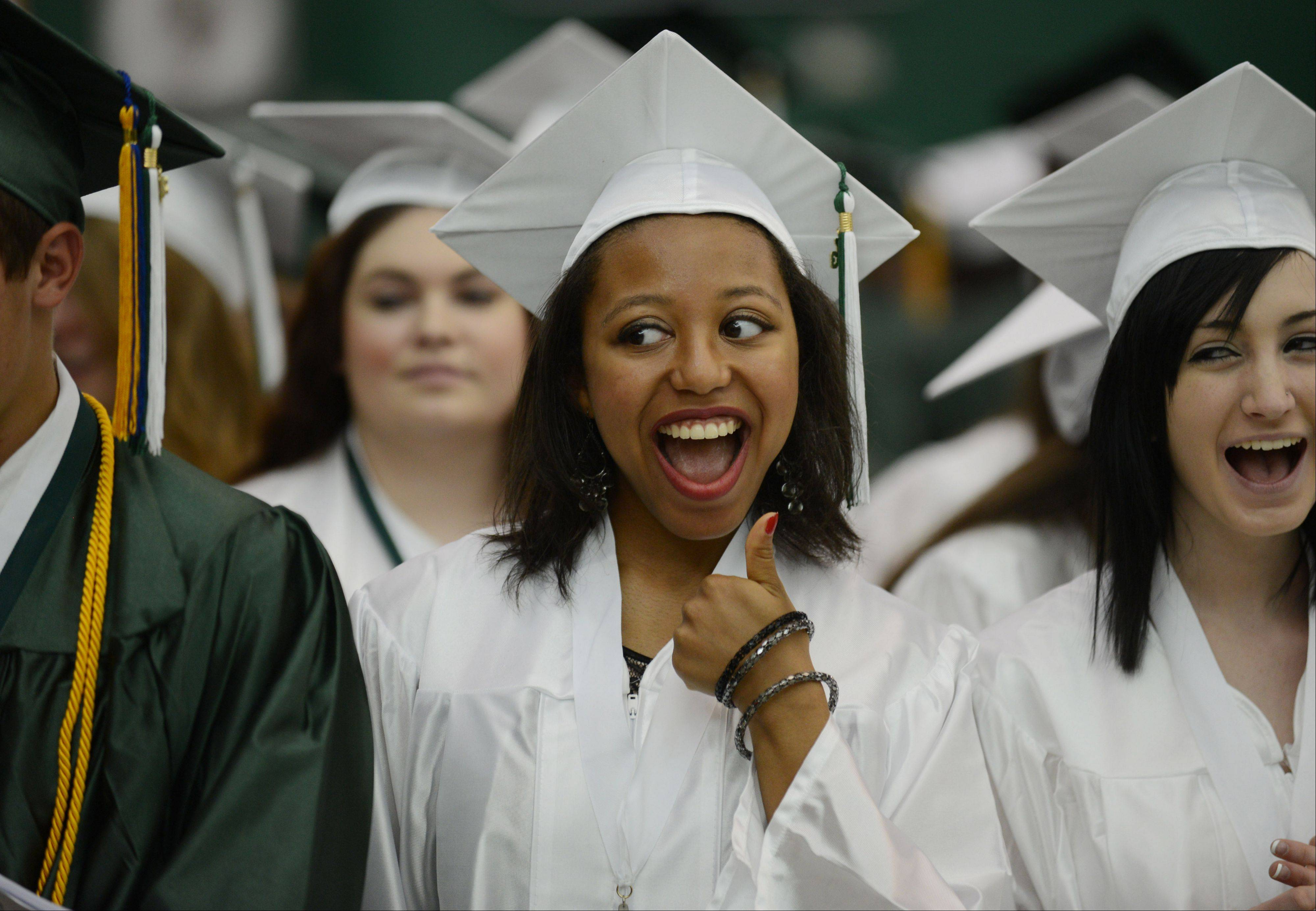 Grayslake Central High School student Miranda Adams gives her mom thumbs up during Sunday's graduation ceremony at the school.