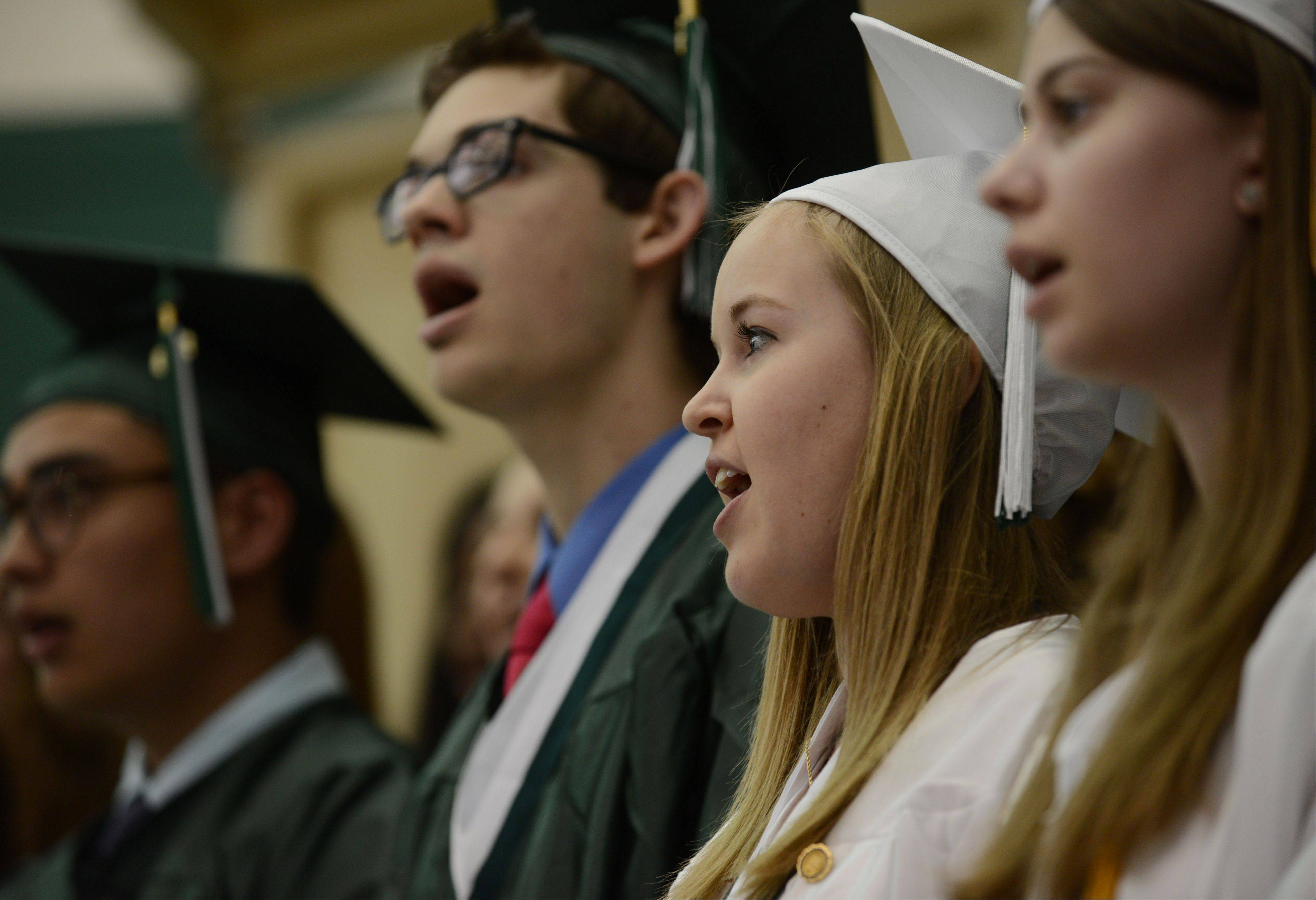 Grayslake Central High School seniors sing in the choir during Sunday's graduation ceremony in Grayslake.