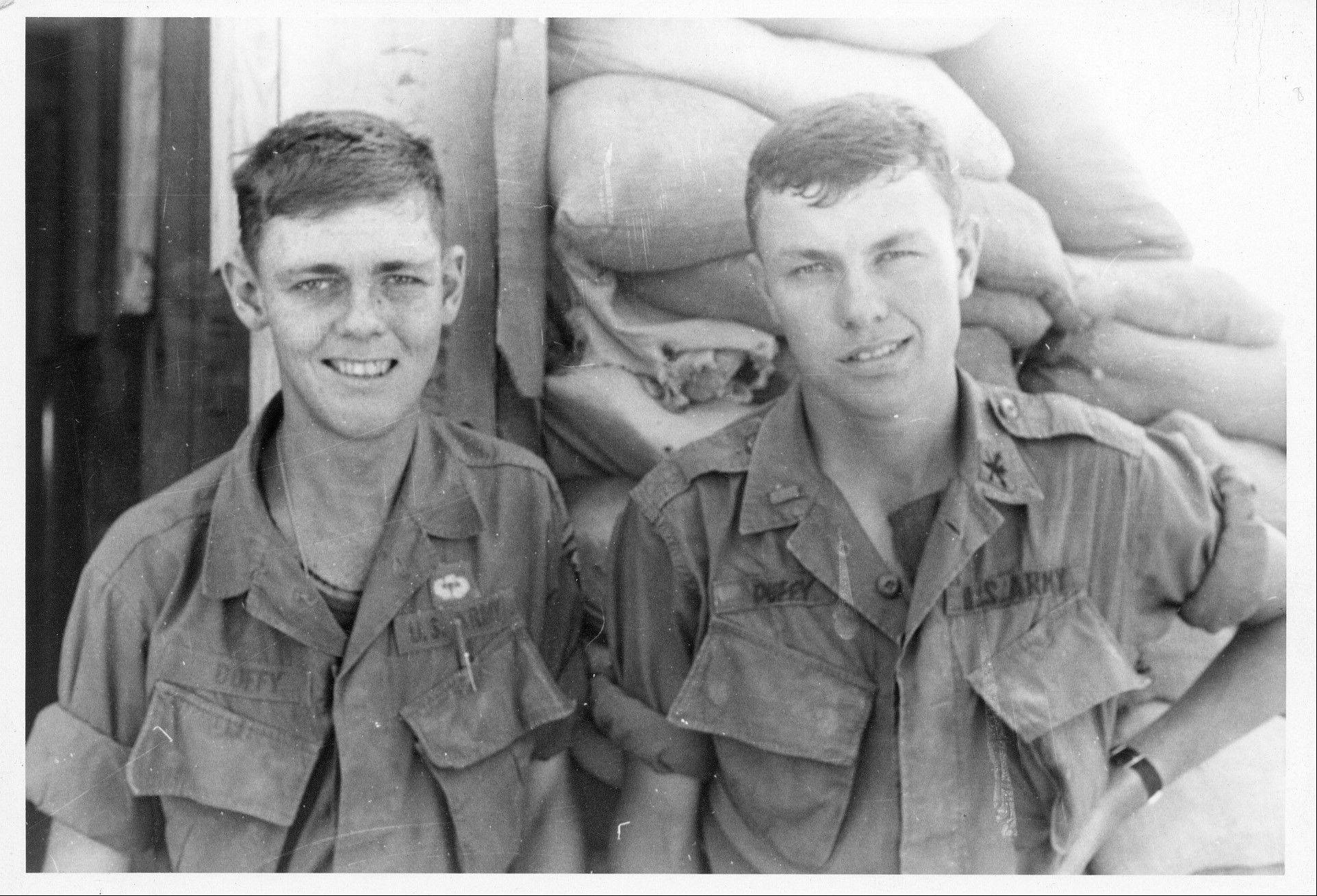 Brothers Dan, left, and Michael Duffy met up for this photograph as their tours of duty in Vietnam overlapped in 1968.