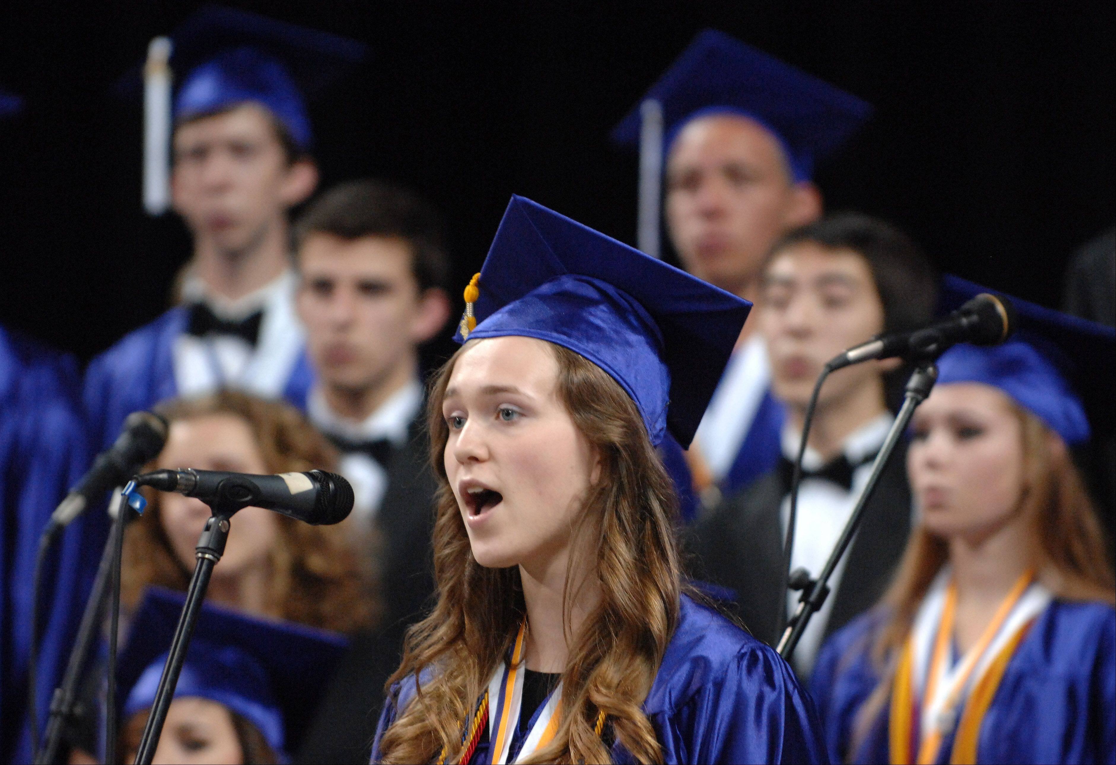 Lexy Bieber performs a solo with the chamber choir during Hampshire High School's graduation ceremony Saturday at the Sears Centre in Hoffman Estates.