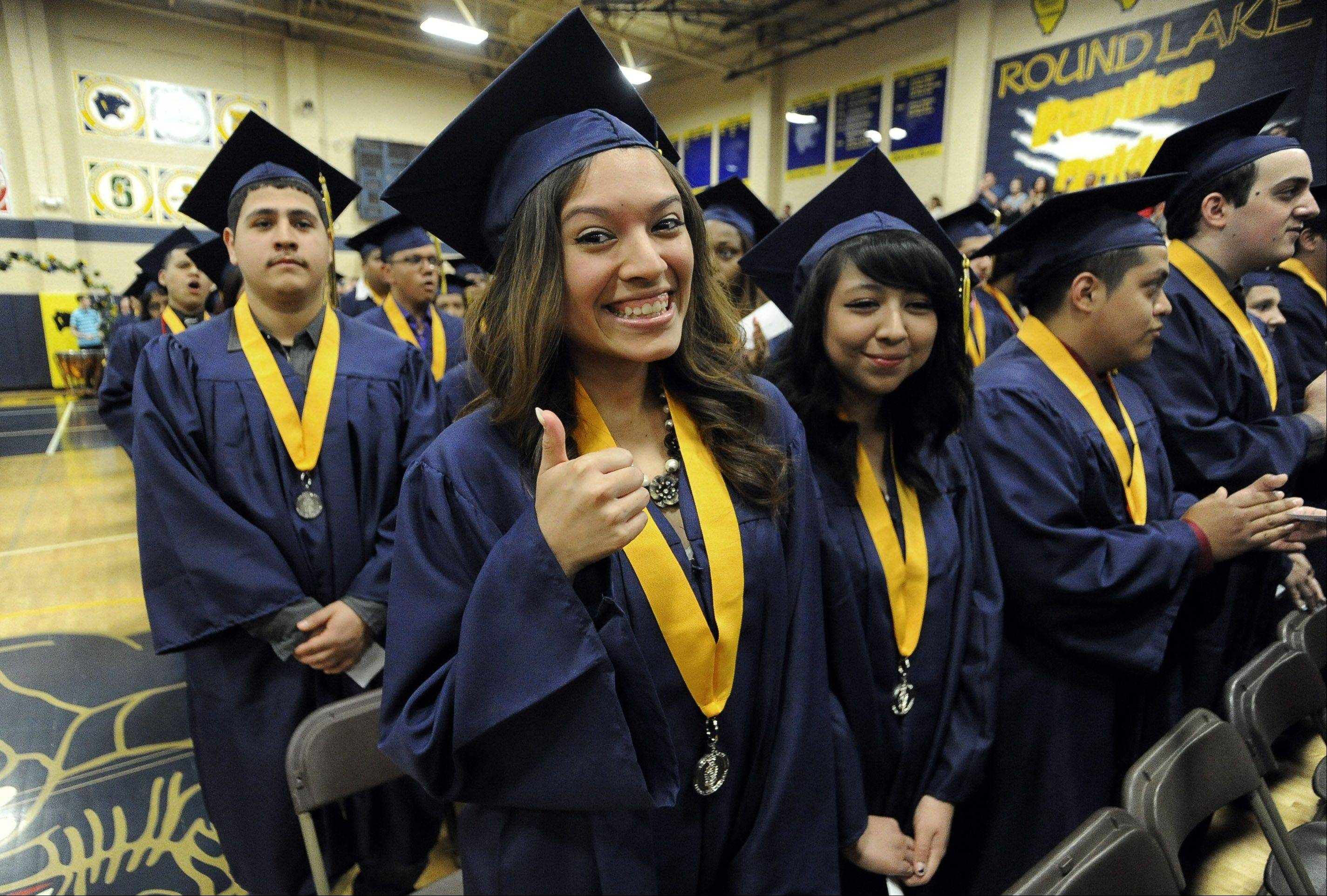 Jaqueline Hernandez gives a thumbs as she takes part in the 59th Commencement of Round Lake High School on Saturday.