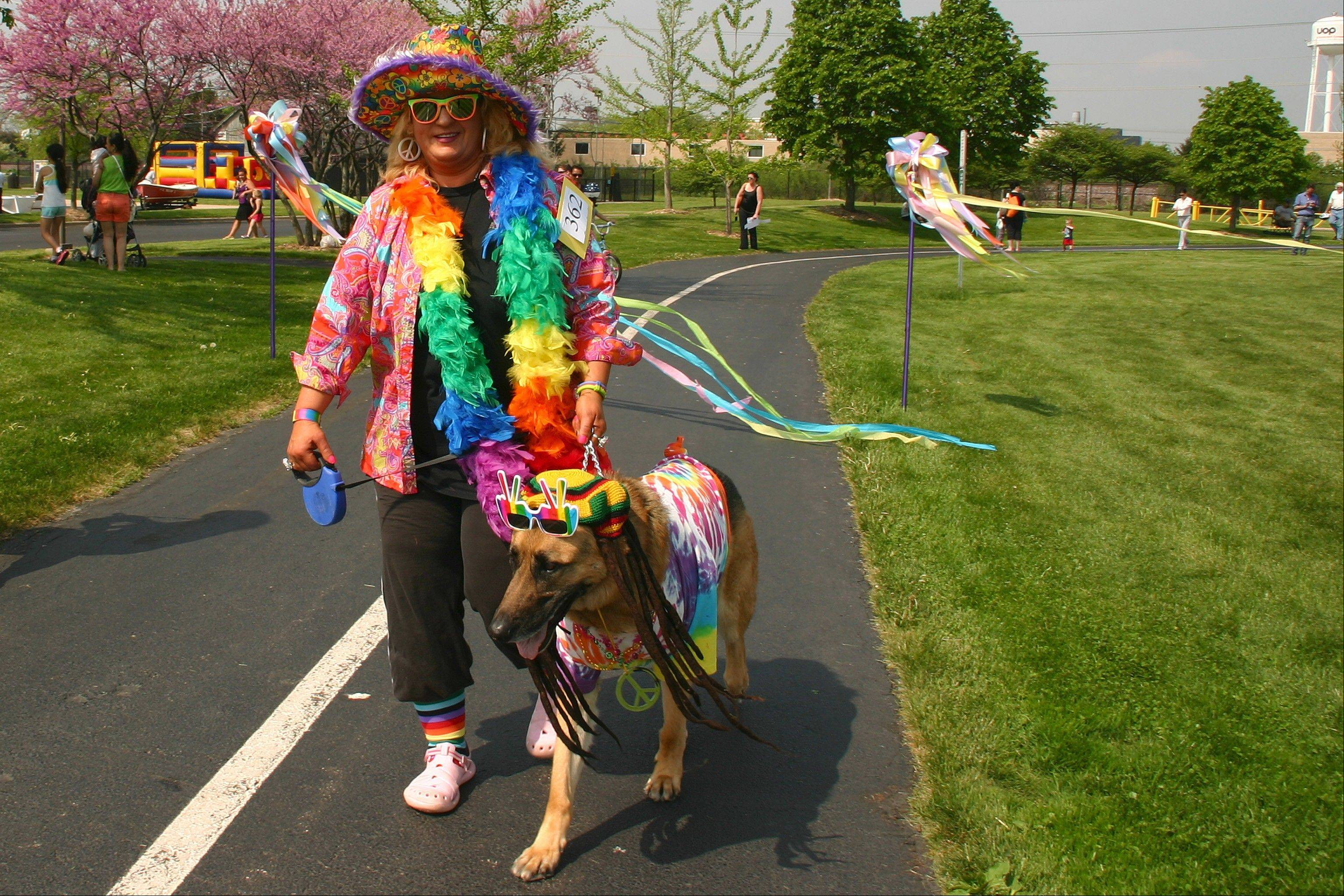 Shelly Pantano and Jackpot, her rescued German Shepherd, won the prize for best theme Saturday at the 11th annual Pooch, Pet, and Pedal Parade.