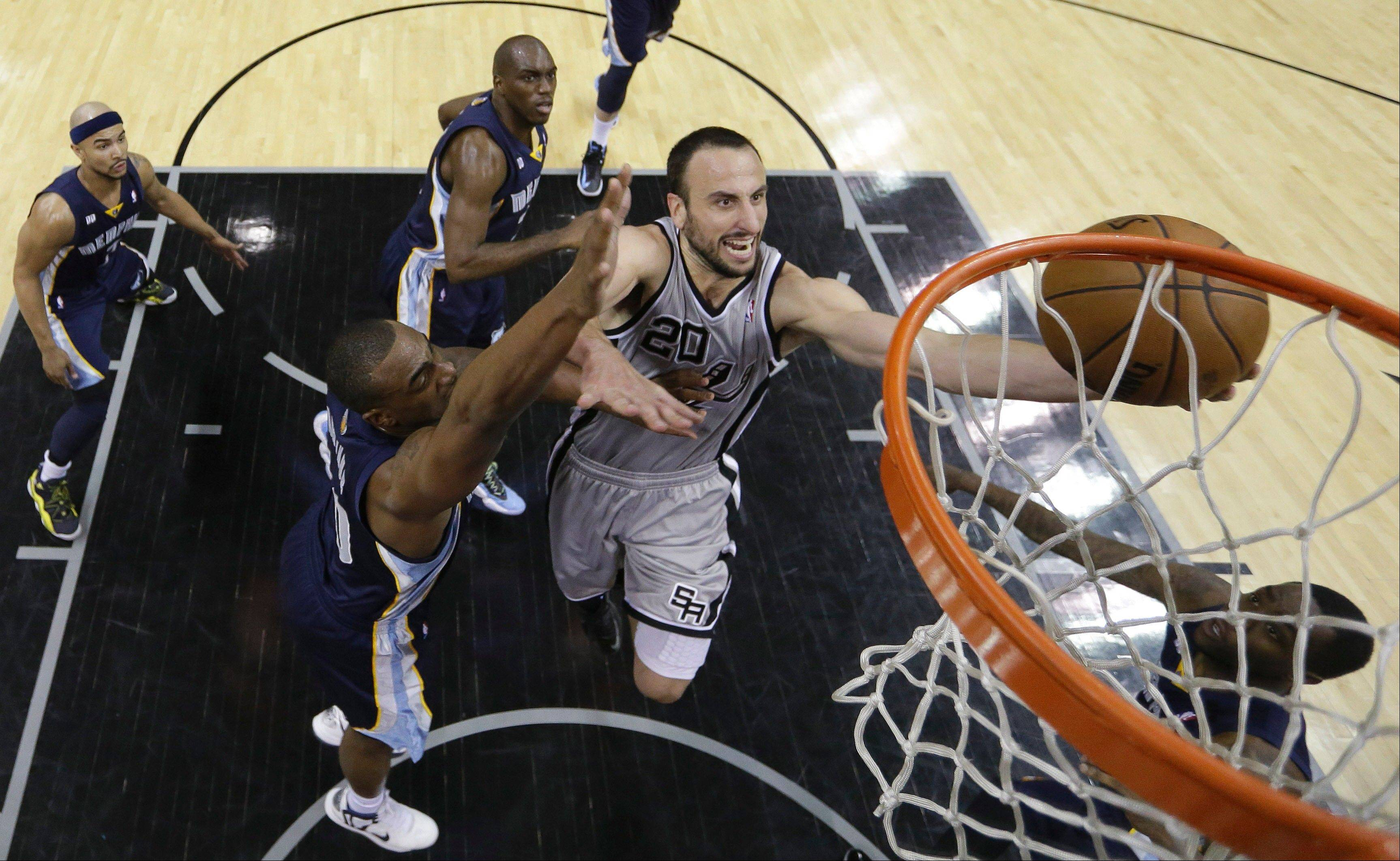 San Antonio Spurs' Manu Ginobili (20), of Argentina, drives to the basket as Memphis Grizzlies' Darrell Arthur, left, defends him during the second half in Game 1 of a Western Conference Finals NBA basketball playoff series, Sunday, May 19, 2013, in San Antonio. San Antonio won 105-83.
