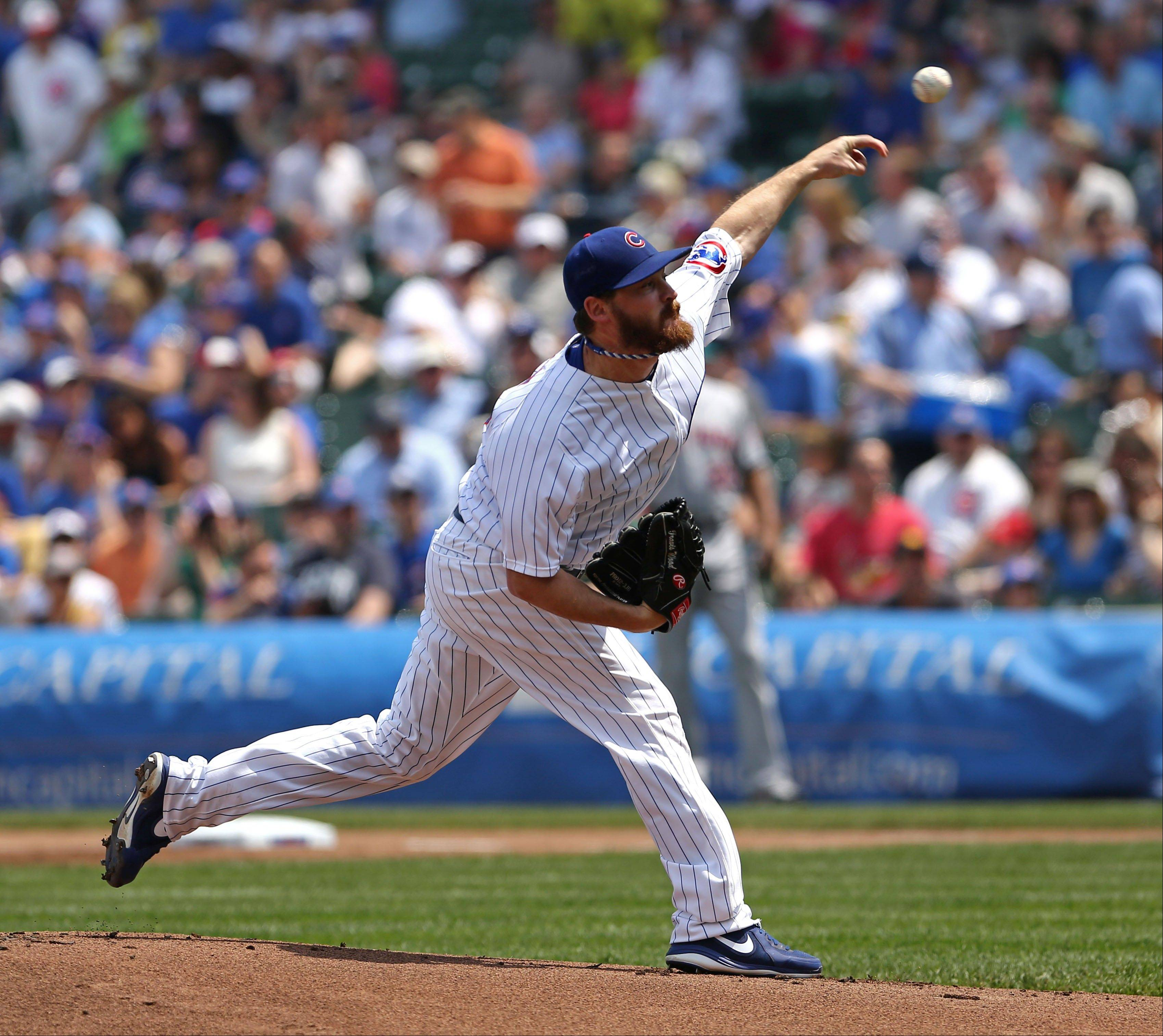 Cubs starting pitcher Travis Wood works against the Mets on Sunday at Wrigley Field.