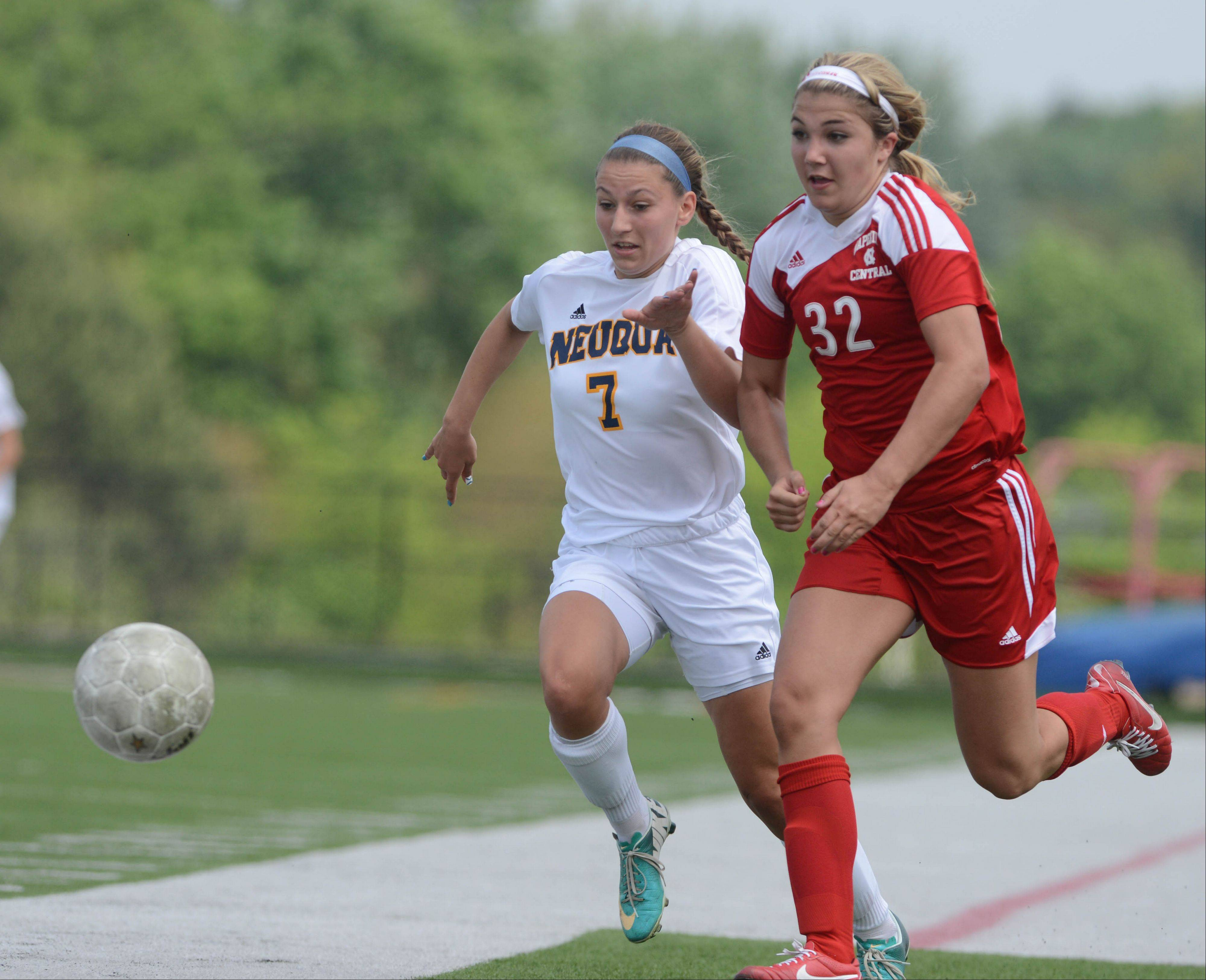 Talise Romain of Neuqua,left, and Abby Joyce of Naperville Central chase the ball during the class 3A Bolingbrook girls soccer regional final Saturday.