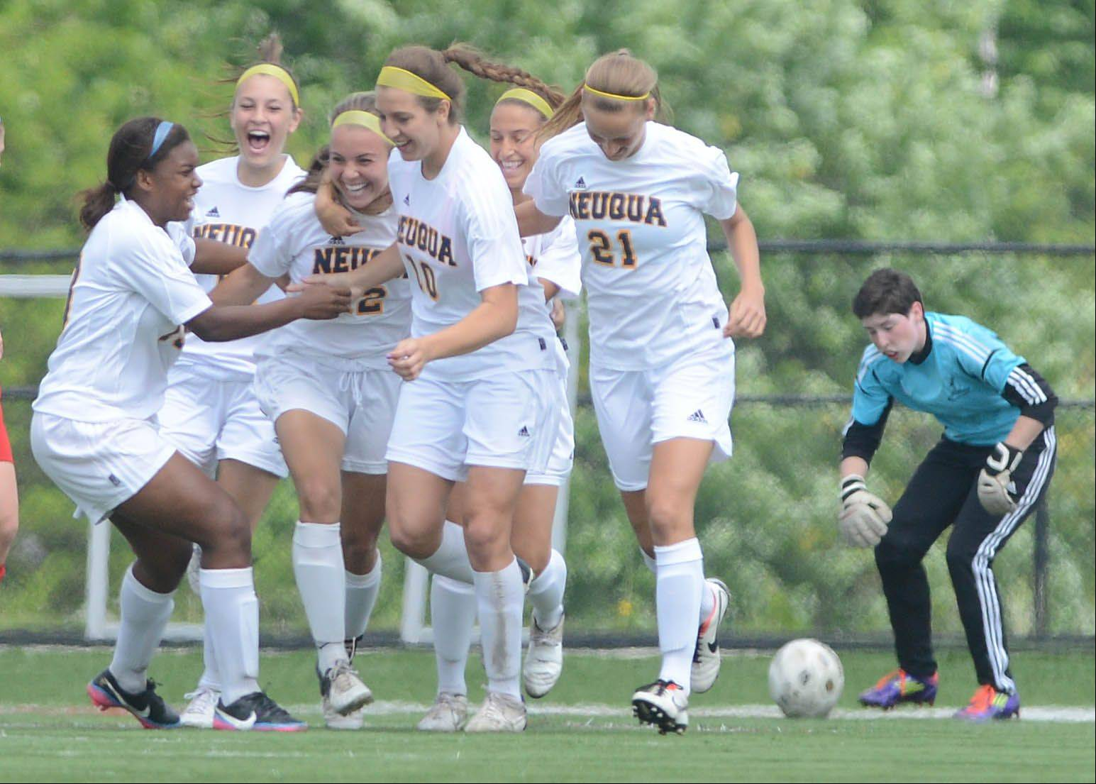 The Neuqua girls celebrate an early goal during the Class 3A Bolingbrook girls soccer regional final Saturday.