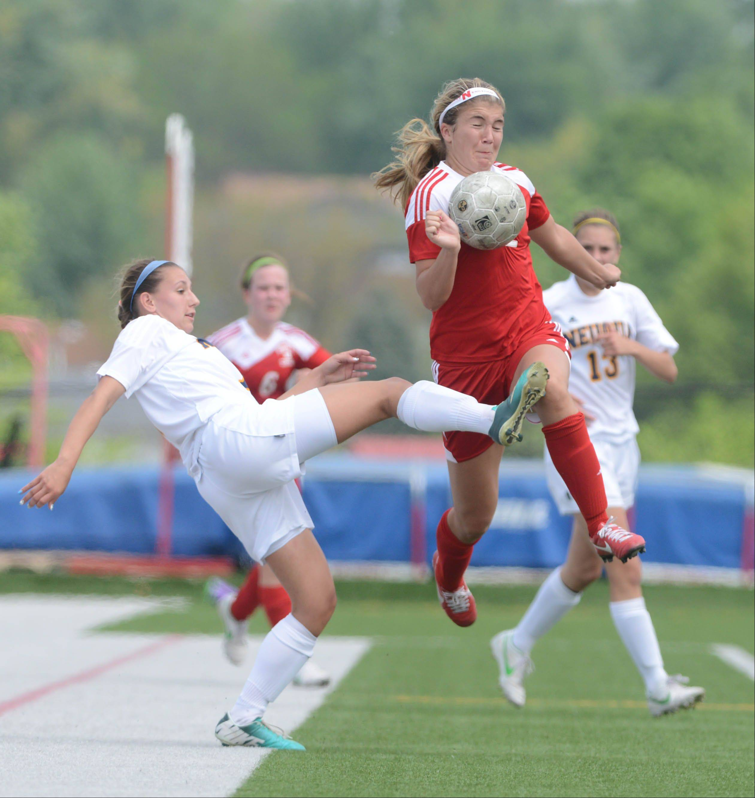 Talise Romain of Neuqua,left, and Abby Joyce of Naperville Central dual for the ball during the class 3A Bolingbrook girls soccer regional final Saturday.