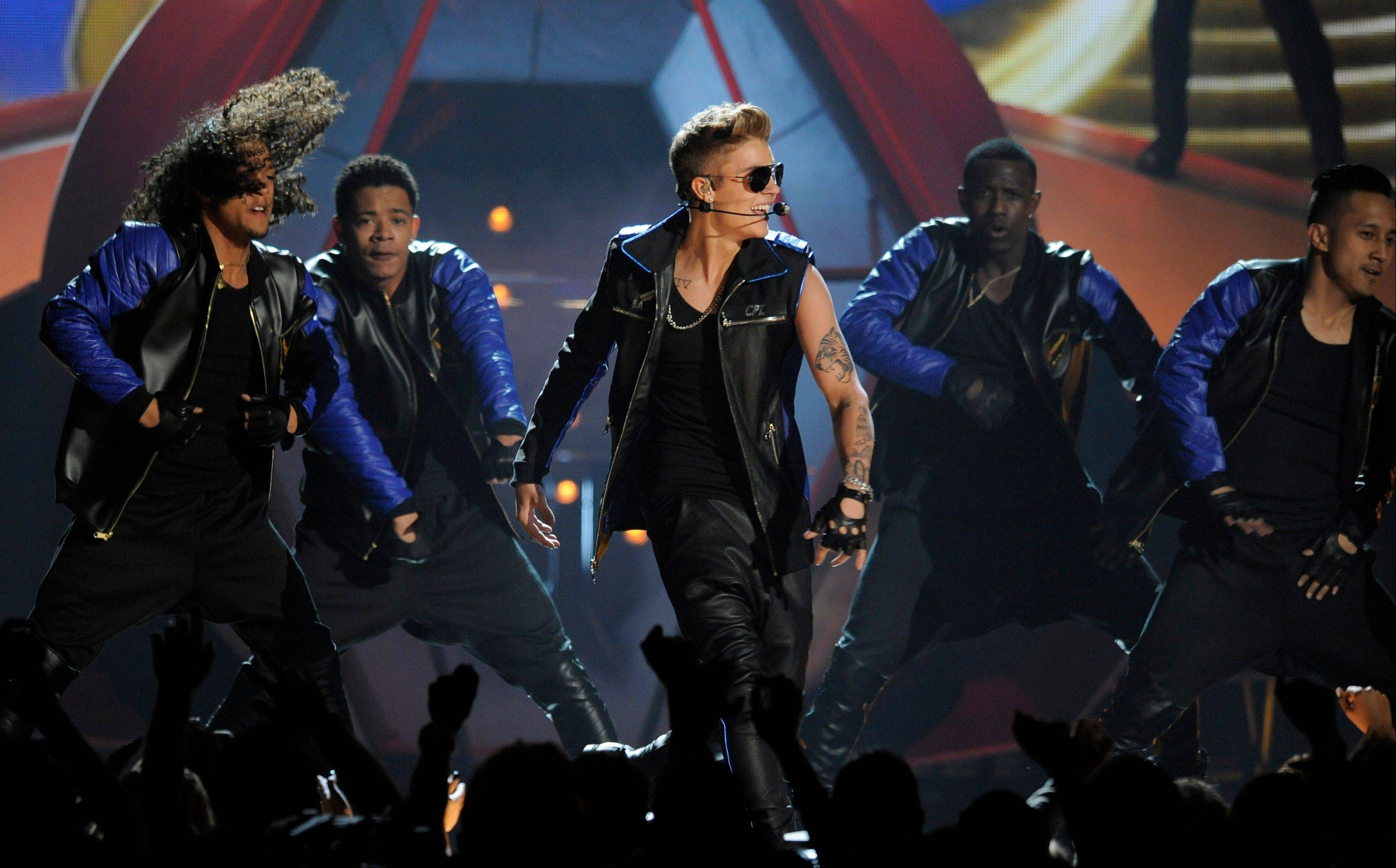 Justin Bieber, center, performs at the Billboard Music Awards at the MGM Grand Garden Arena on Sunday, May 19, 2013 in Las Vegas.