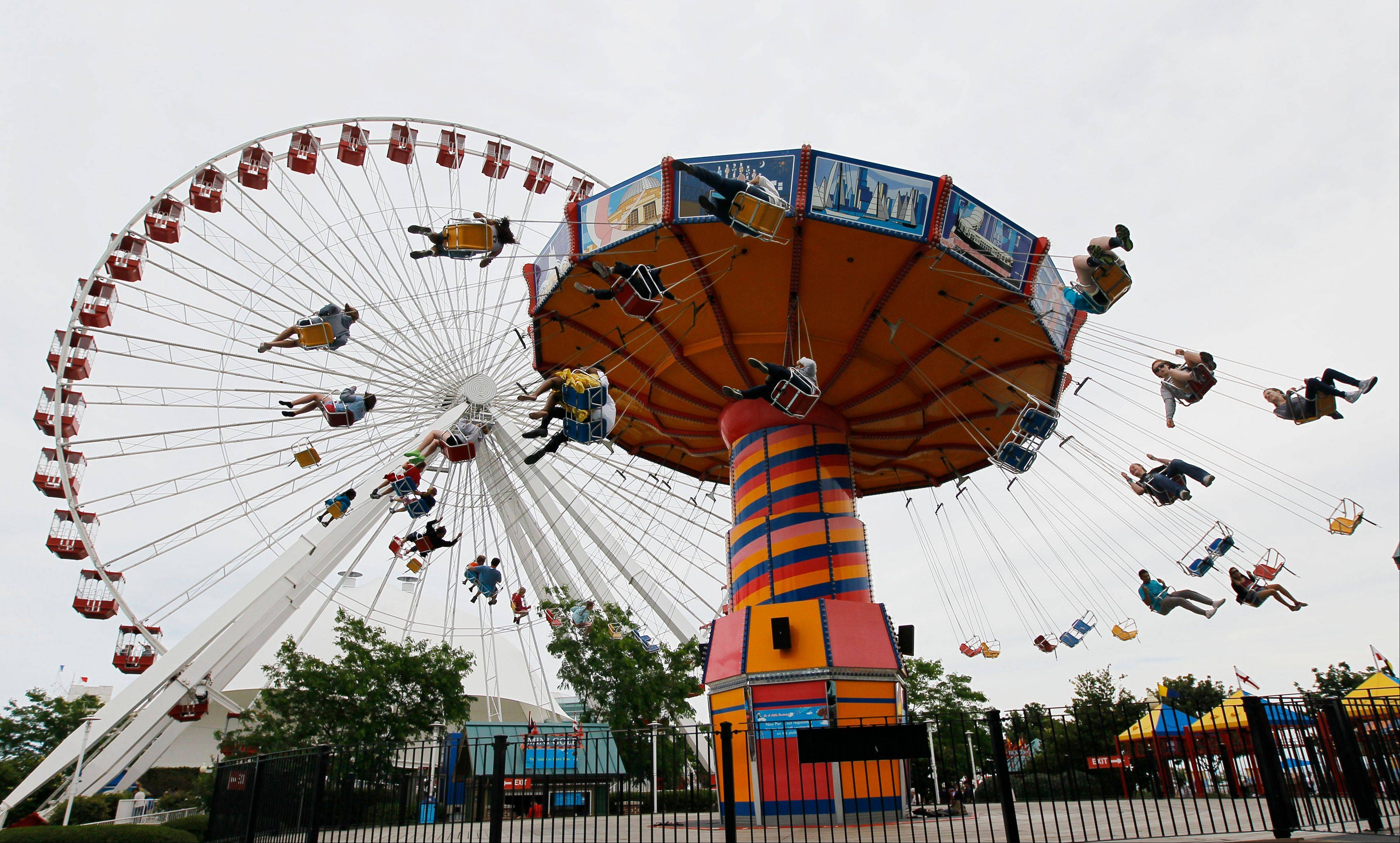 Clinton Shepherd, park operations manager at the Navy Pier, rode Navy Pier�s Ferris wheel for more than two days over the weekend, bringing the world record for the longest ride to the birthplace of the amusement park favorite.