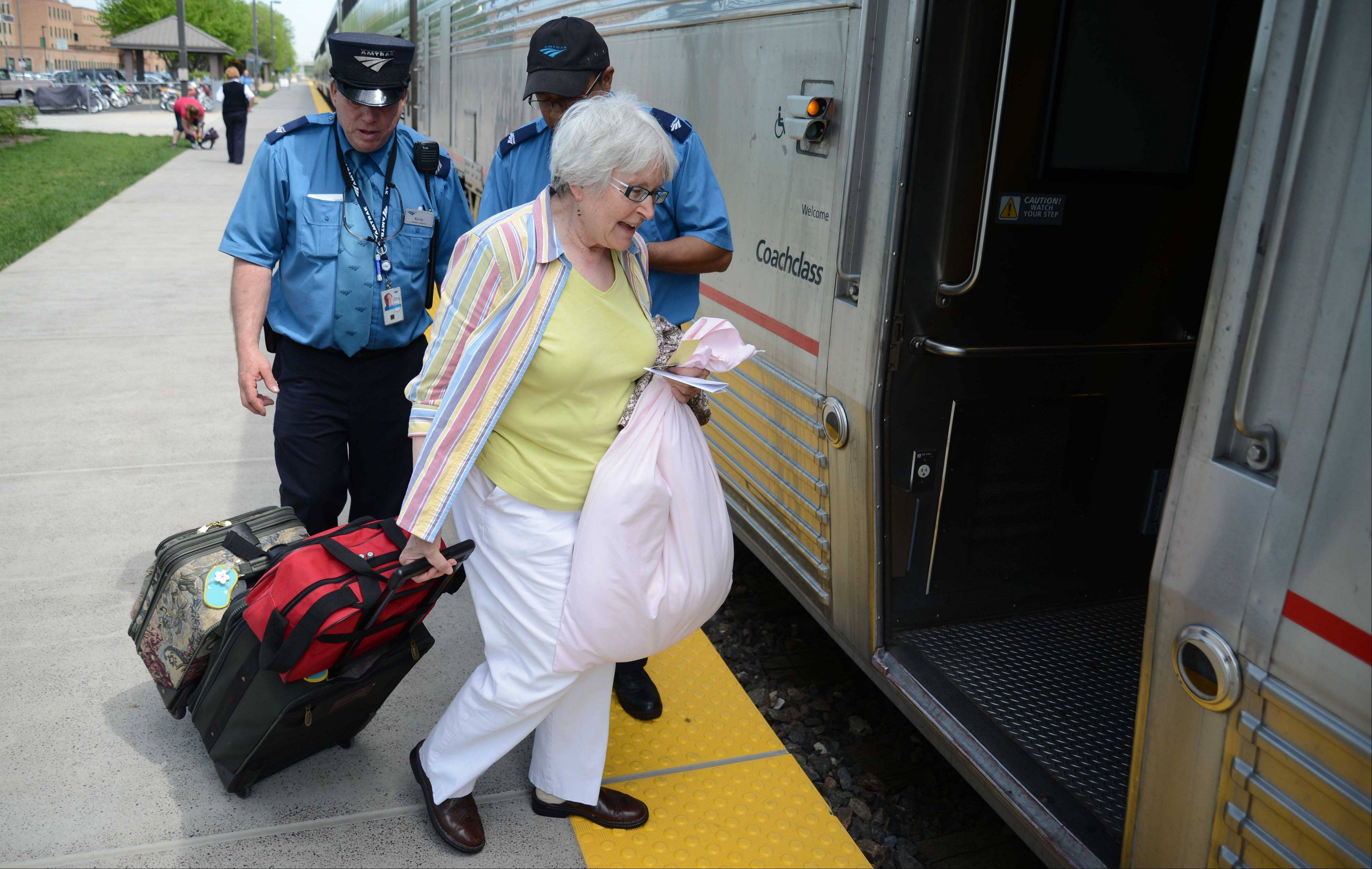 Tyra Harris of Denver boards the Amtrak's California Zephyr in Naperville. She was heading home after a visit with relatives in Lombard.