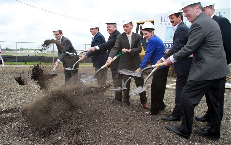 Prospect Heights Mayor Nicholas Helmer, fourth from left, Susan Shea, director of the Illinois Division of Aeronautics, and Wheeling Village President Dean Argiris lift the shovels during a groundbreaking for a new facility by Hawthorne Global Aviation Service that includes a new hangar, executive terminal and executive offices on the Prospect Heights side of the Chicago Executive Airport.
