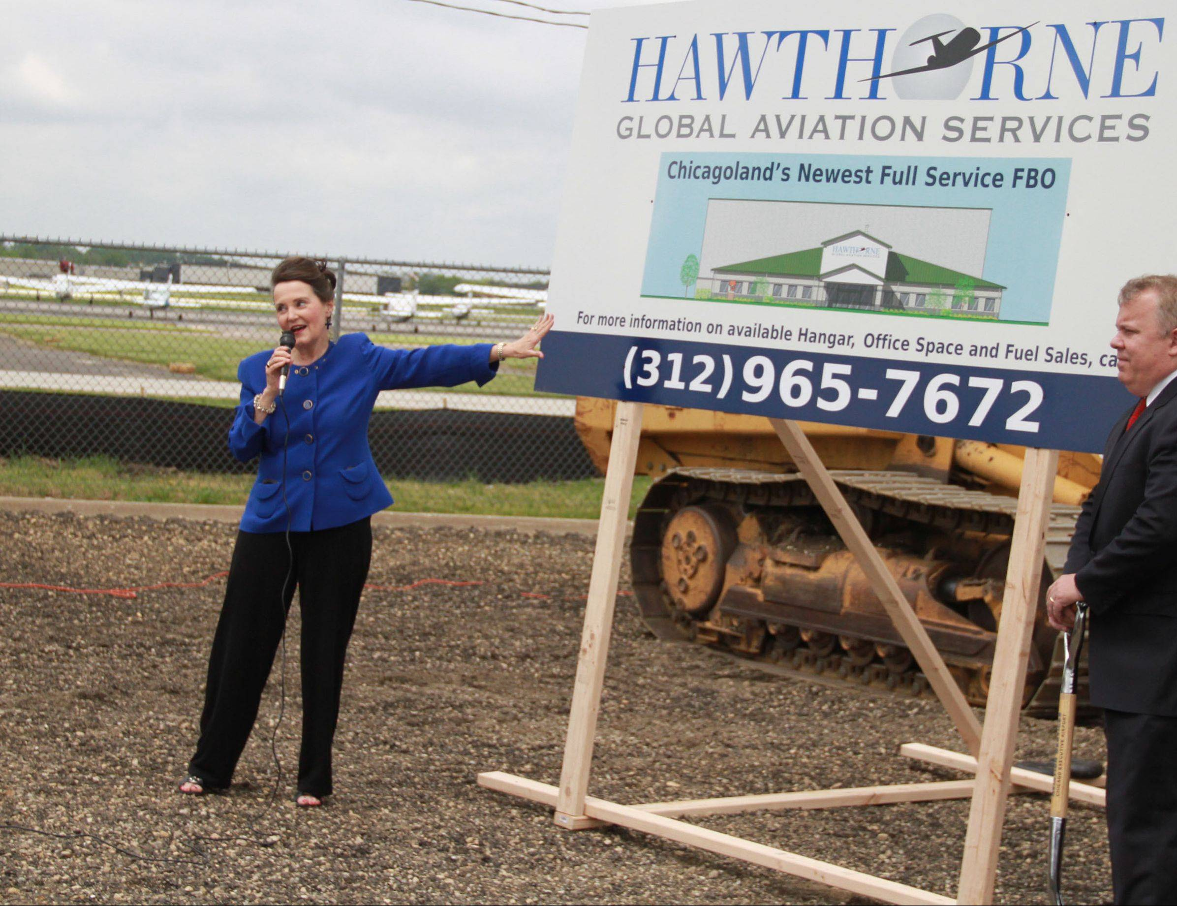 Susan Shea, director of the Illinois Division of Aeronautics, speaks during a groundbreaking for a new facility by Hawthorne Global Aviation Service at Chicago Executive Airport.
