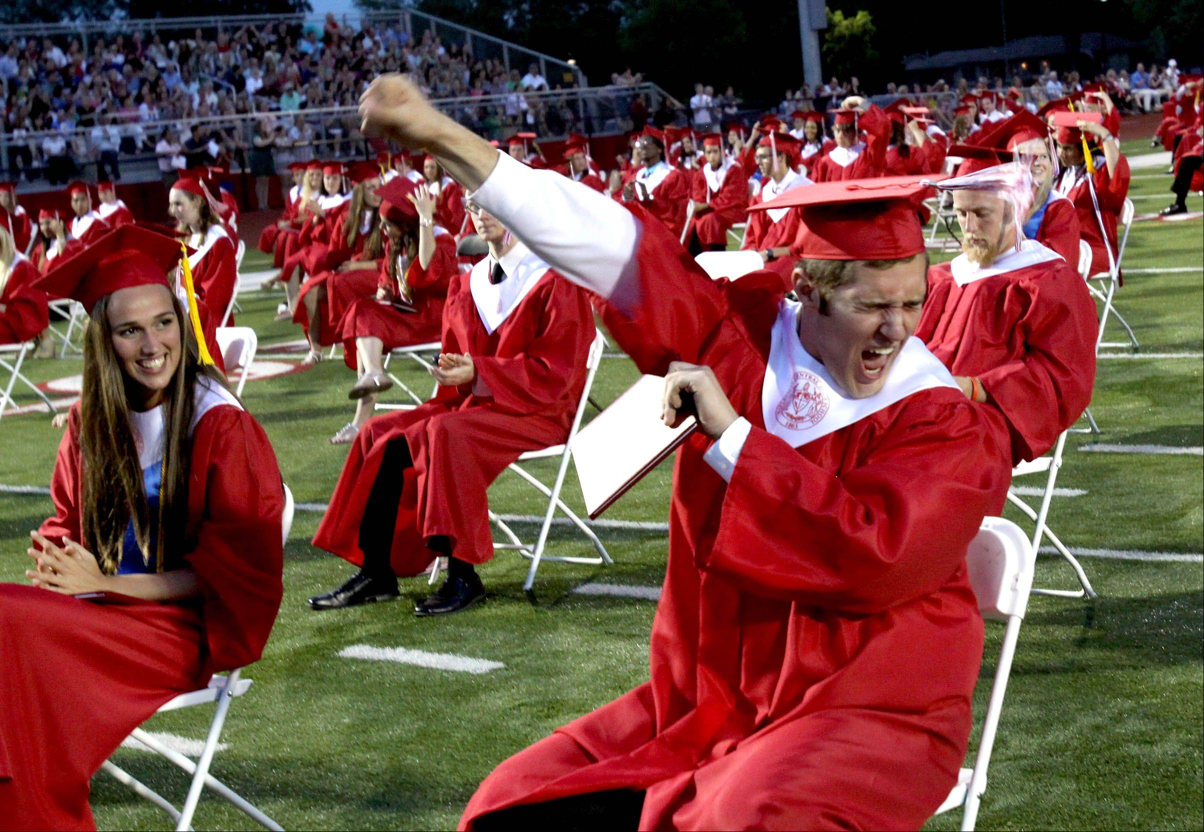 Tom Borkowicz reacts after the Naperville Central graduation on Monday.