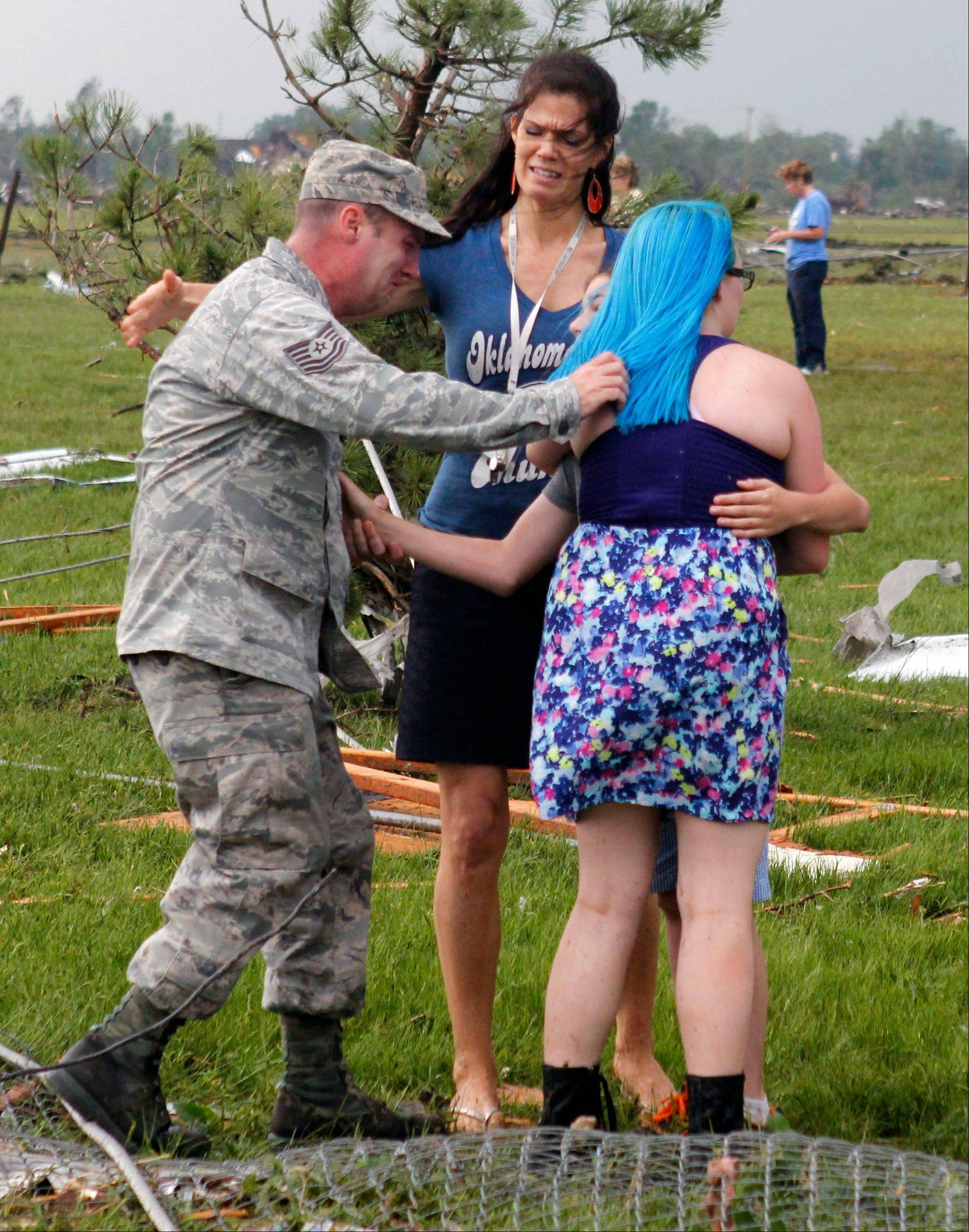 Parents reunite with their children at Briarwood Elementary school after a tornado destroyed the school in south Oklahoma City, Monday, May 20, 2013. Near SW 149th and Hudson.
