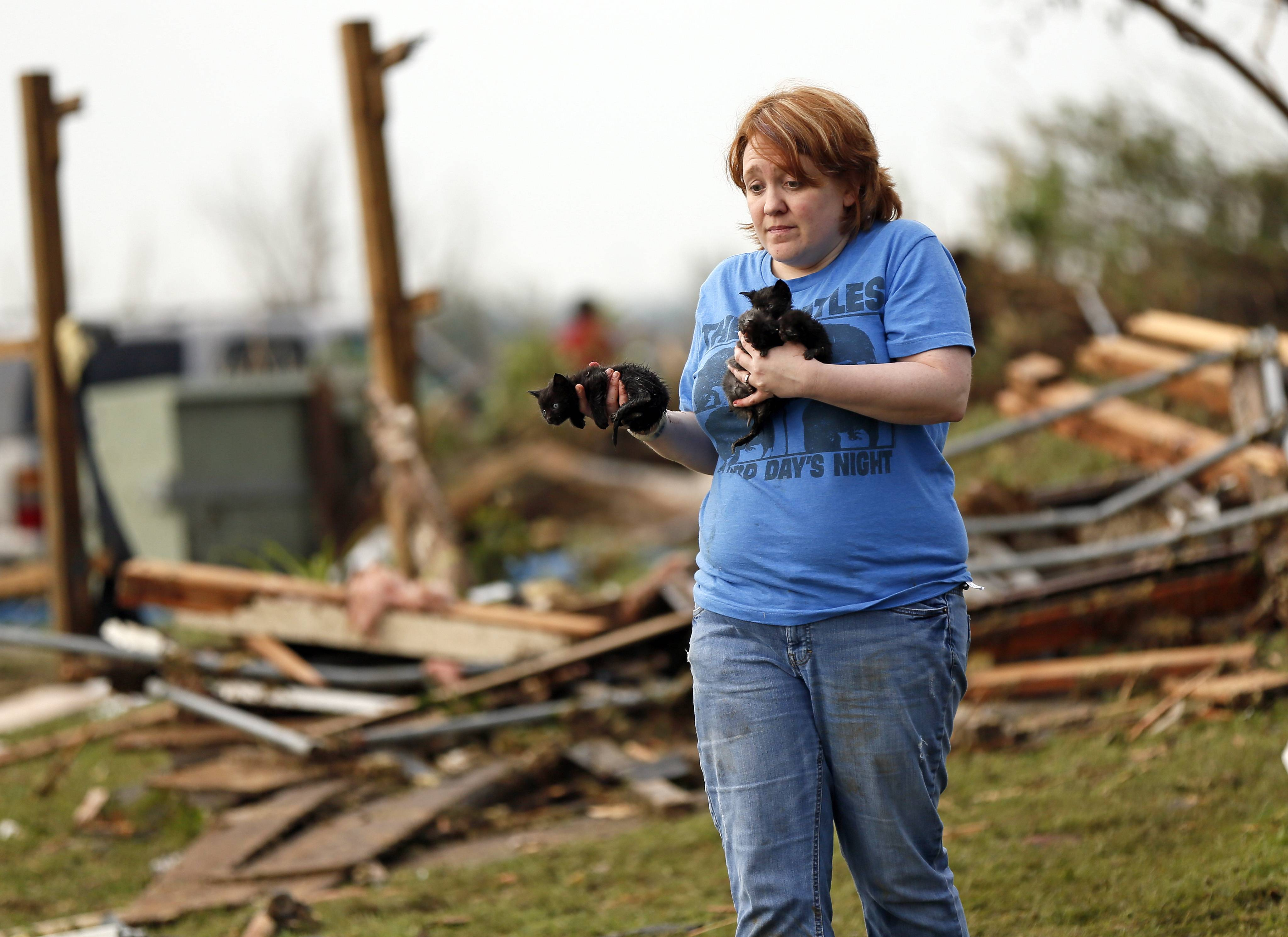Rachel Hilton holds stray kittens she found in the debris of her parents' home at SW 149th and Stone Meadows Dr. after a tornado struck south Oklahoma City and Moore, Okla., Monday, May 20, 2013.