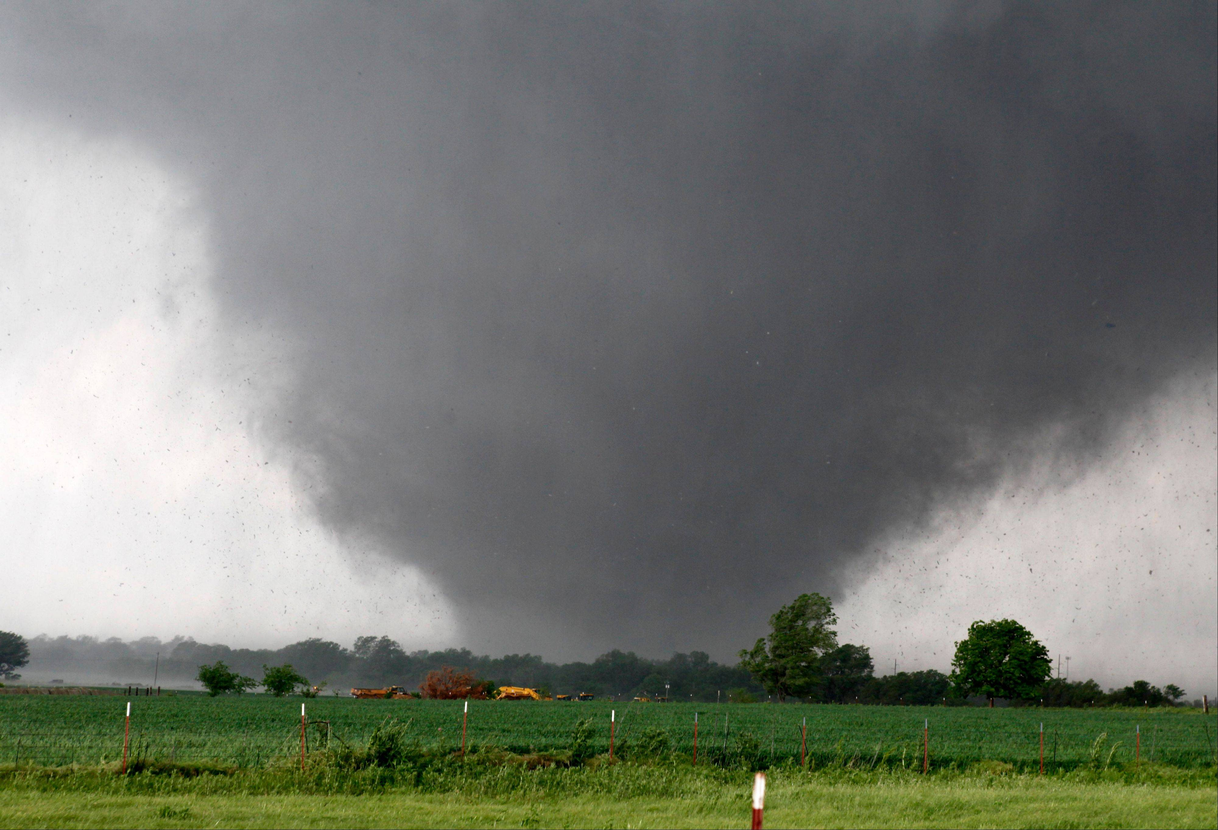 A tornado passes across south Oklahoma City, Monday, May 20, 2013. A monstrous tornado roared through the Oklahoma City suburbs, flattening entire neighborhoods with winds up to 200 mph, setting buildings on fire and landing a direct blow on an elementary school.