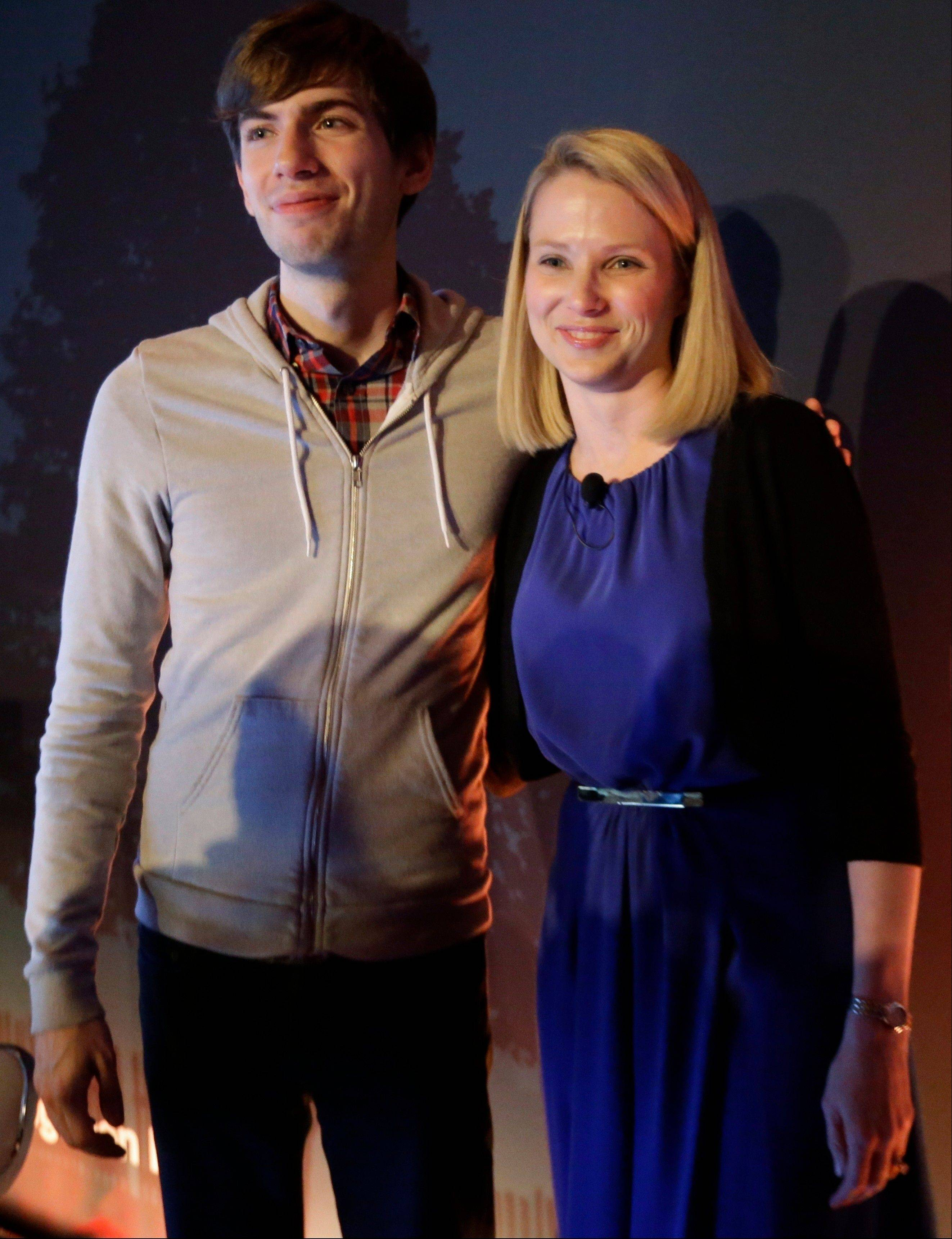 Yahoo CEO Marissa Mayer, right, and Tumblr Chief Executive David Karp pose for photographs after a news conference Monday in New York.